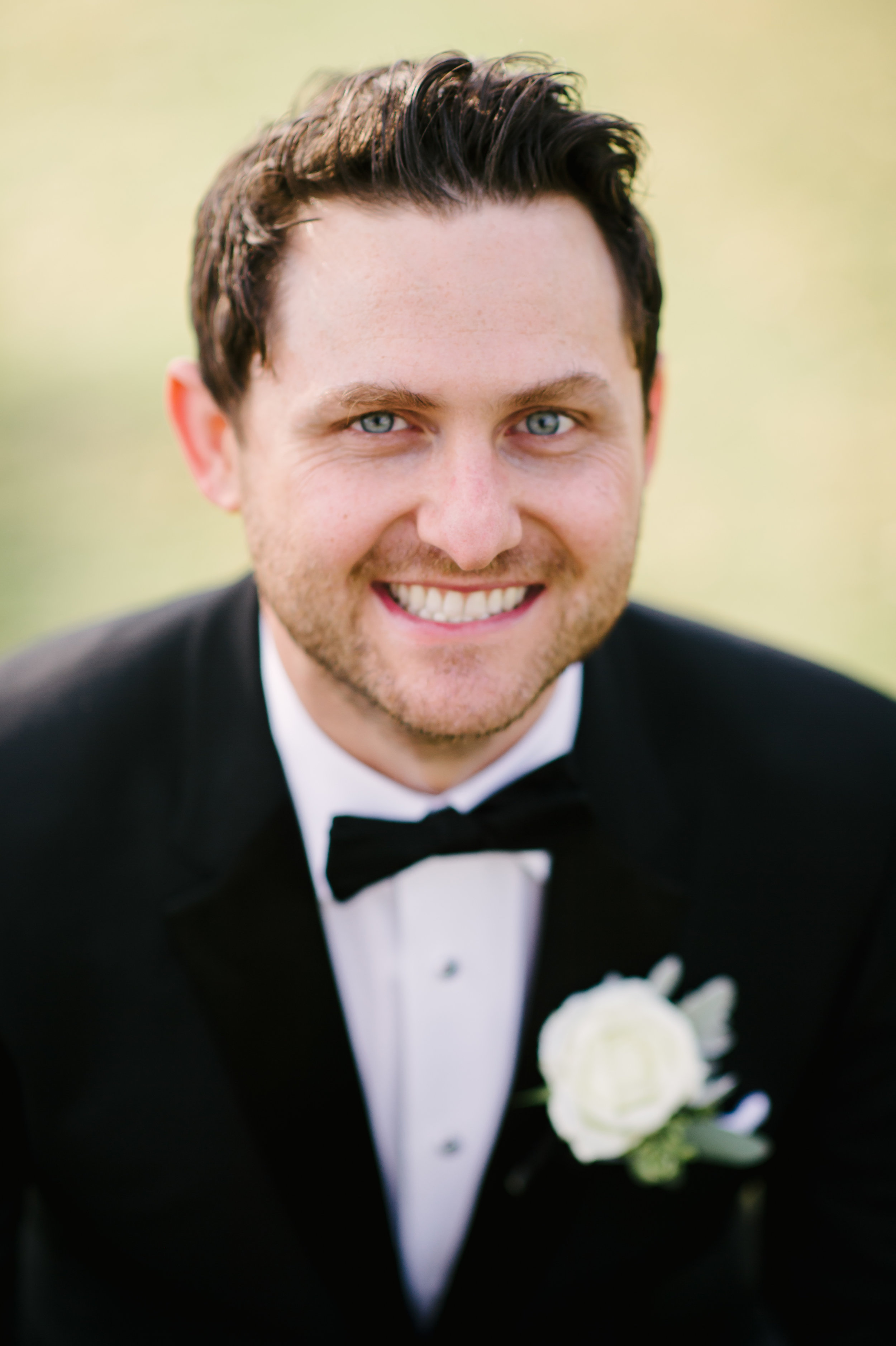 The groom sported a black tux accented with an ivory garden rose boutonniere.