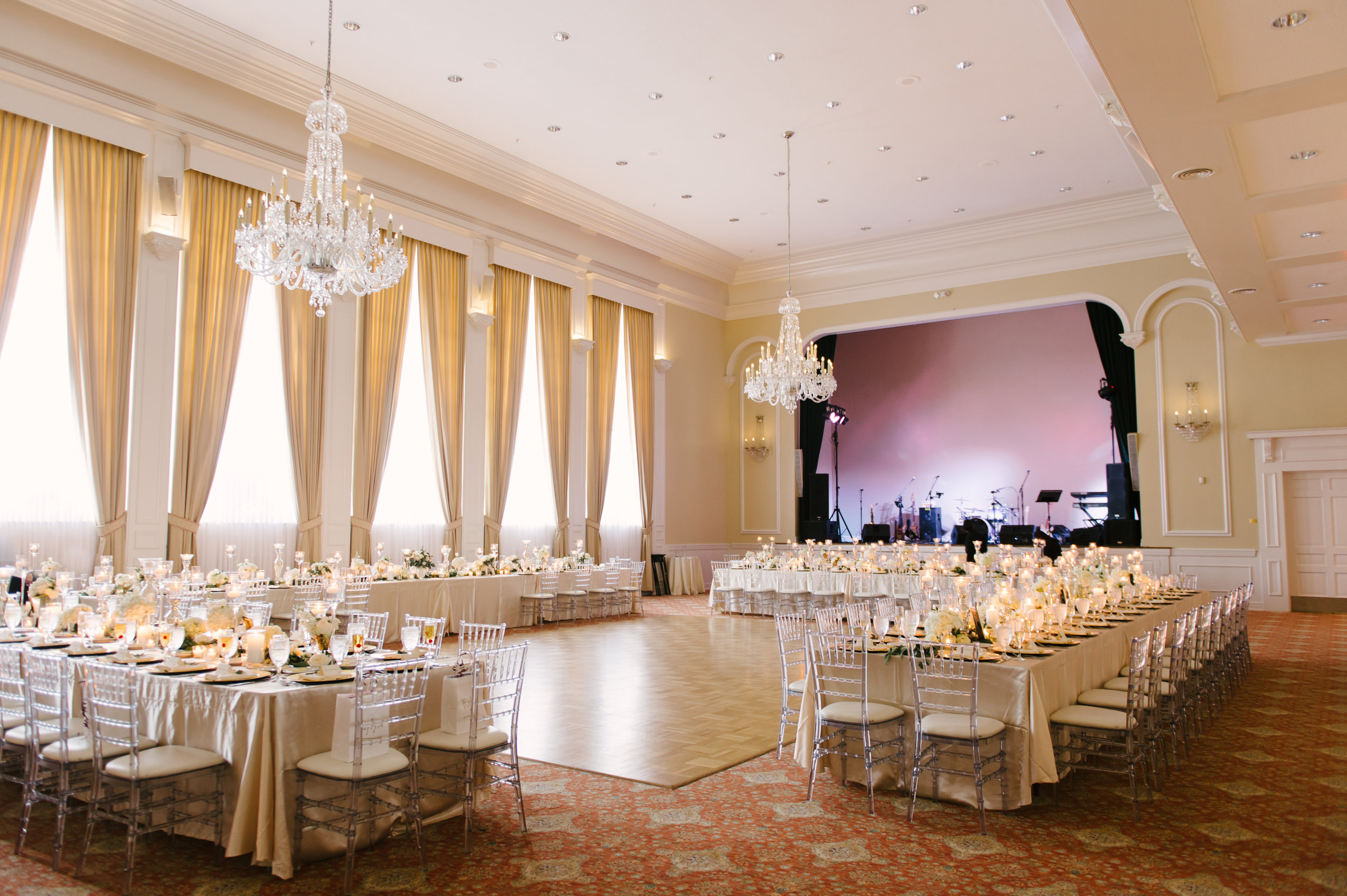 Guests enjoyed a formal plated meal and champagne toast at long feasting tables under crystal chandeliers.