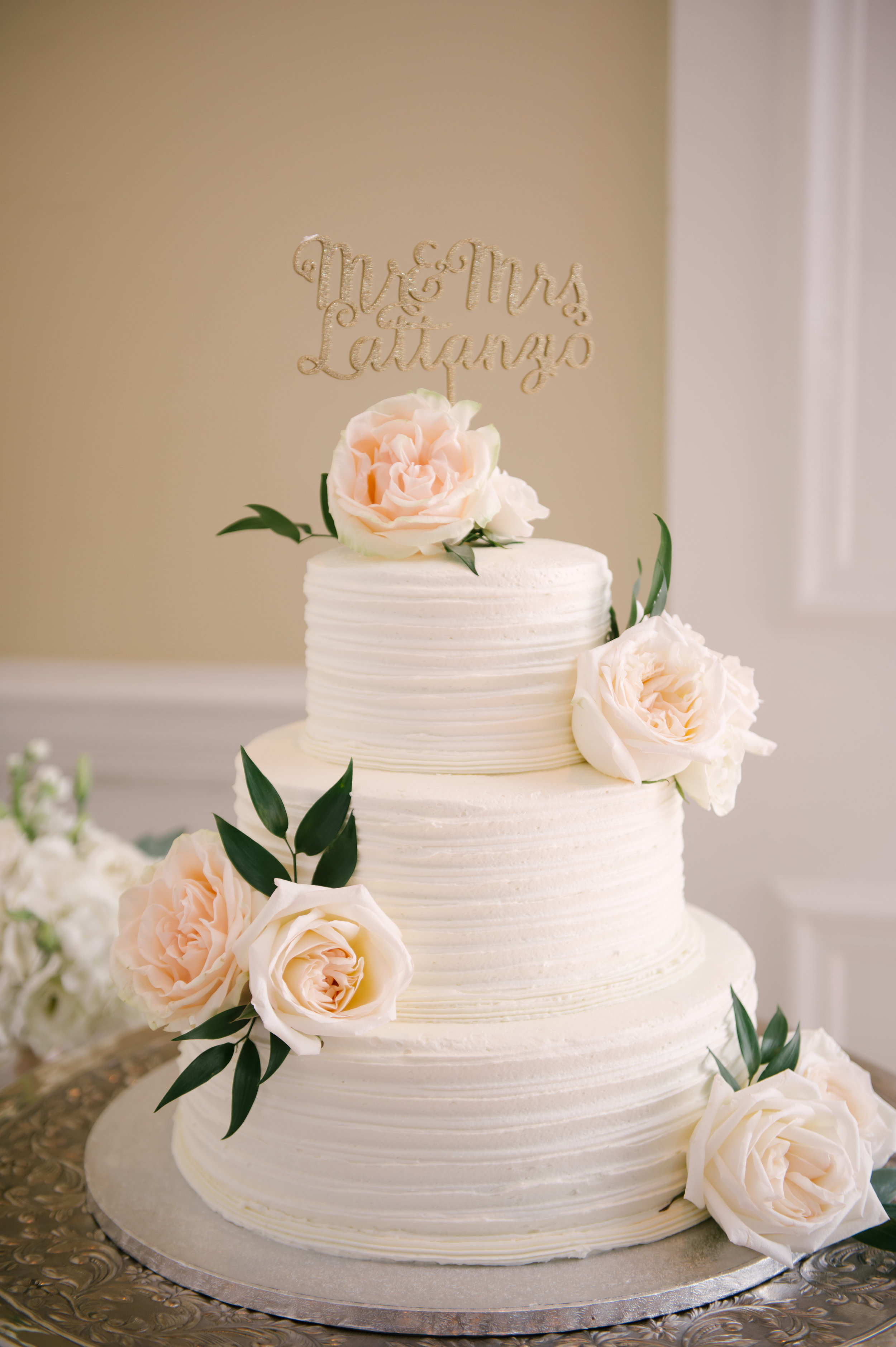 The simple yet stunning three tiered ivory cake accented with neutral florals and greenery, reflected the timeless and elegant style of the wedding. And how cute is that custom gold cake topper?!