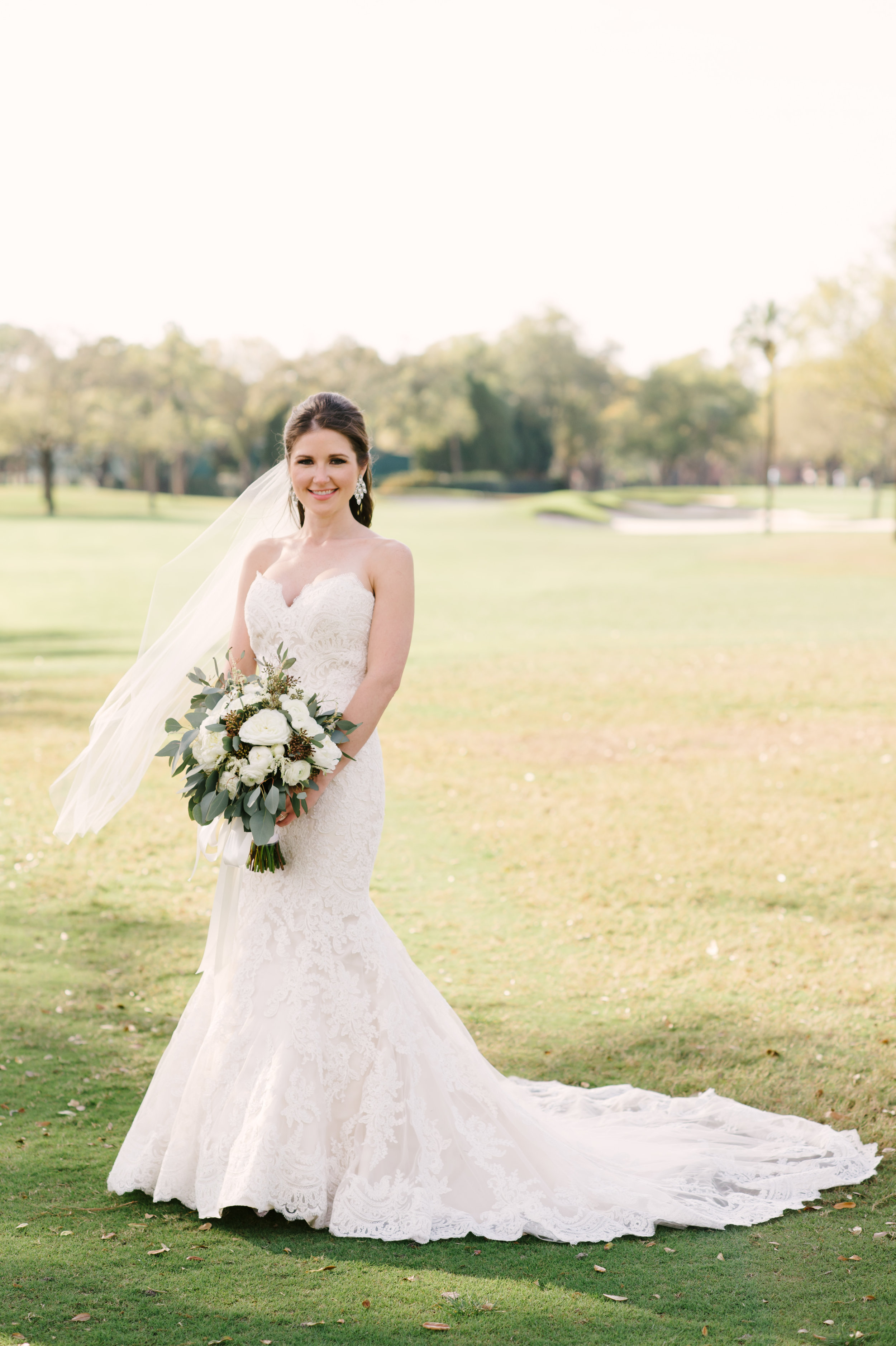 The stunning bride in her gorgeous ivory lace trumpet style gown.