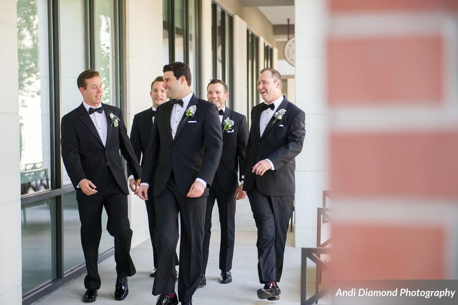 The groom and groomsmen looked sharp in their classic black and white tuxes.