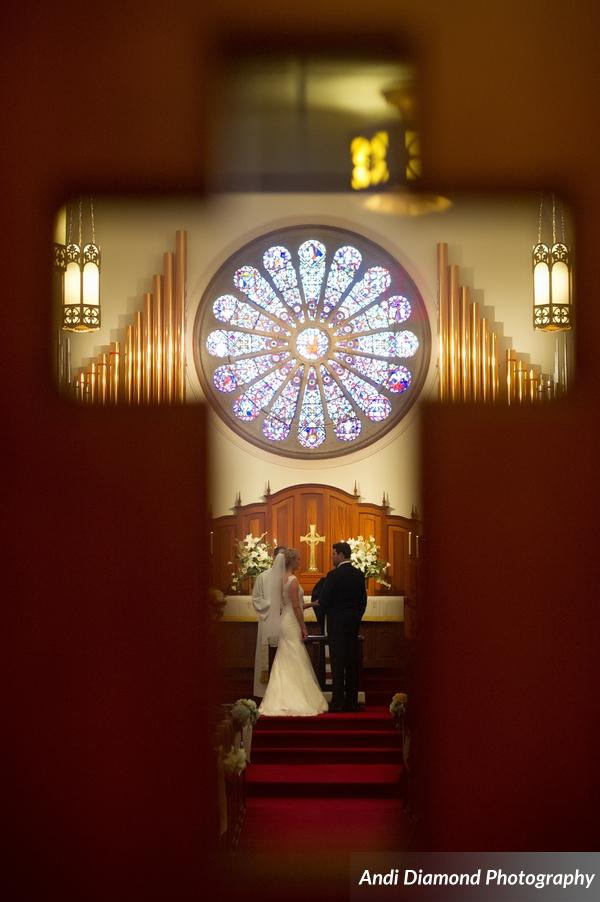 A stunning stained glass mosaic window was set above the couple as they got married in their family church.