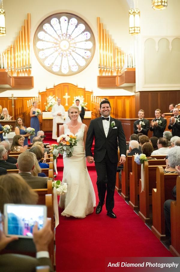 The new Mr. & Mrs. were showered with cheers and love as they descended down the ceremony aisle together.