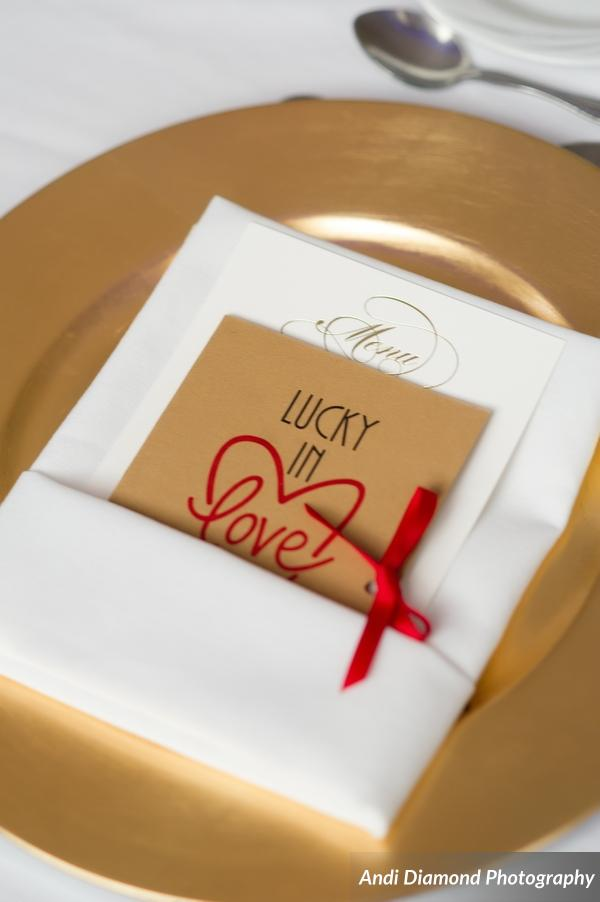 "Guests were ""Lucky in Love"" as they received Lotto ticket favors tucked into sweet little envelopes at each place setting."