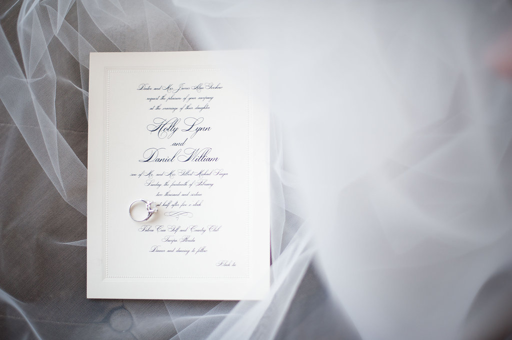 Every detail exuded elegance and sophistication, from the stunning Kleinfeld's gown to the custom ivory Crane stationary with navy script.