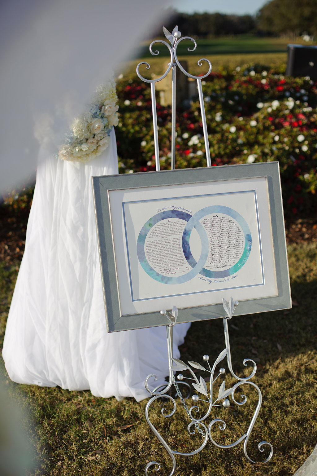 Tradition and elegance were combined during the ceremony, with a ketubah displayed for all to admire under the chuppah adorned with roses and hydrangea.