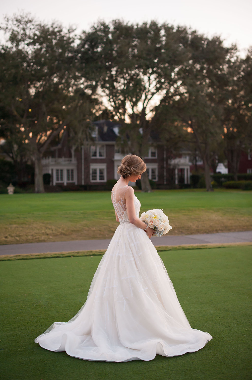 The bride looked absolutely picturesque with buttons cascading down the back of her gown, and the sunset illuminating her on the green of the Palma Ceia golf course.
