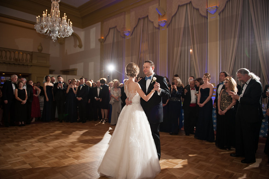 The couple sharing their first dance under the crystal chandeliers.
