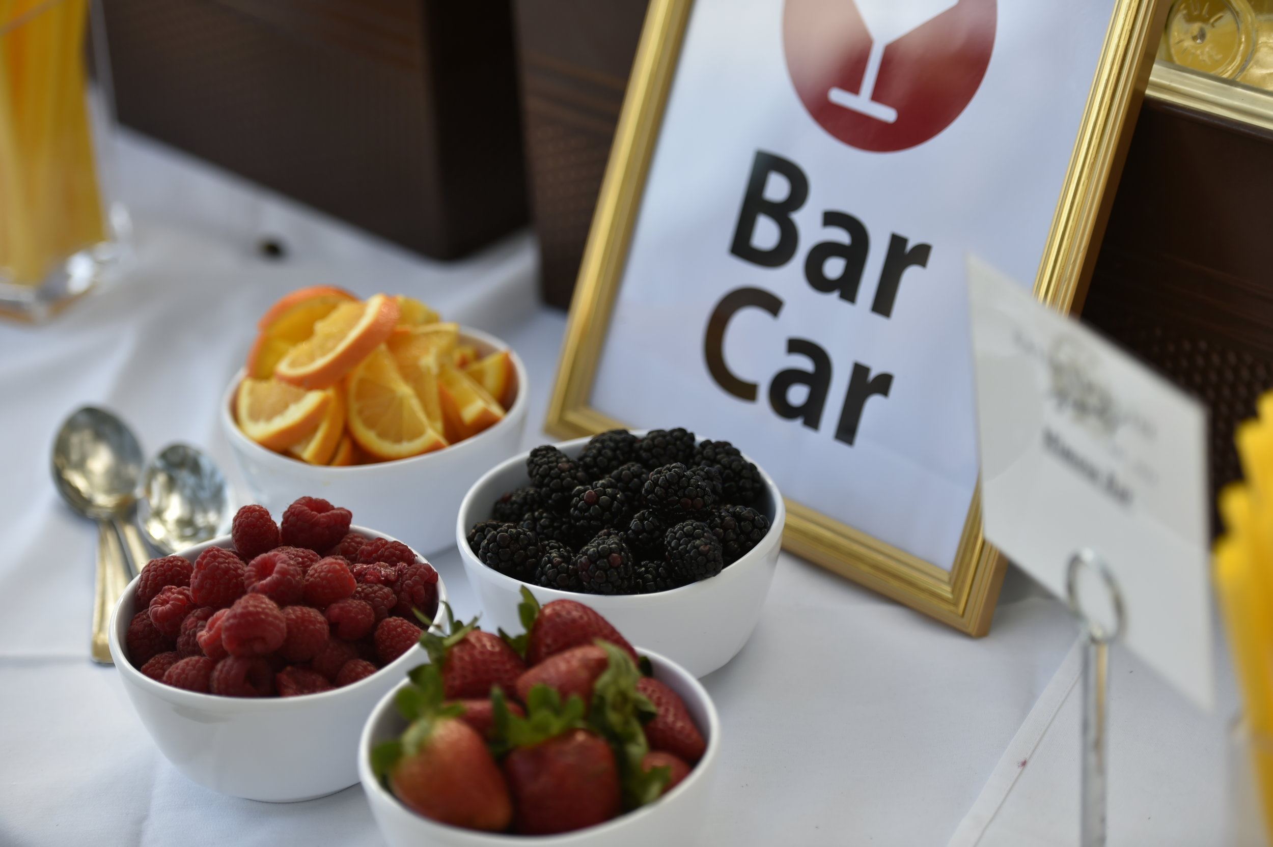 A mimosa 'bar car' provided guests with fresh fruit, juice, and champagne to whip up fun and fresh concoctions.