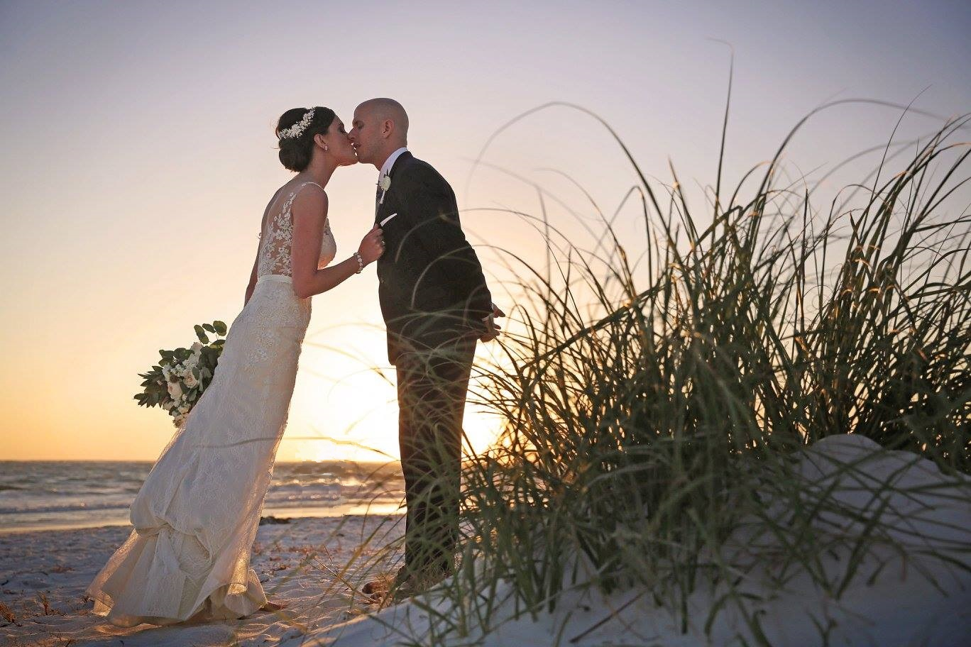 A kiss at sunset on Siesta Key, extra special to the couple because of their proposal story!