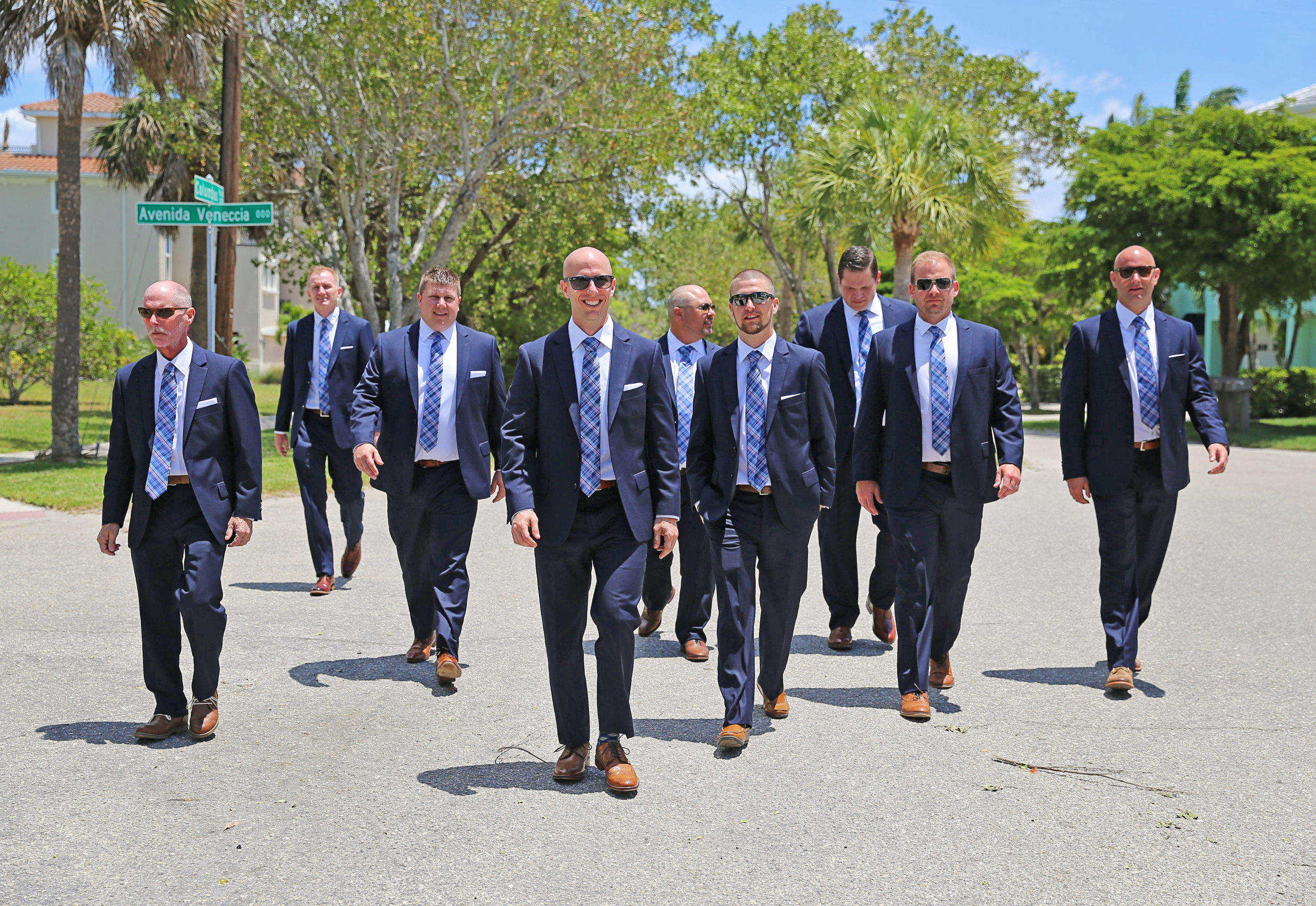 The groomsmen wore matching navy suits, perfect for a chic island wedding.