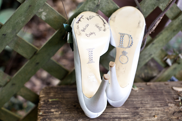 To create a lifelong keepsake out of her bridal heels, the bride had each of her bridesmaids sign the bottom.