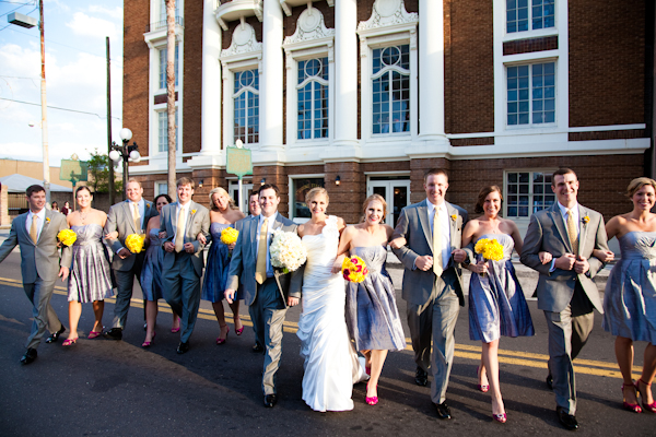 The wedding party looking sharp in shades of grey with bright pops of sunshine yellow in bouquets and boutonnieres.