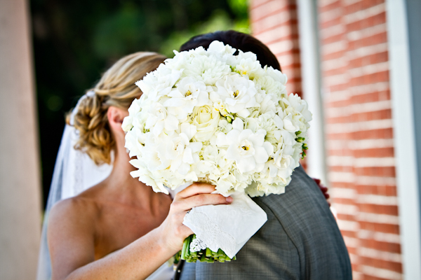 The bride carried a gorgeous ivory bouquet of hydrangea, roses, and gardenia.