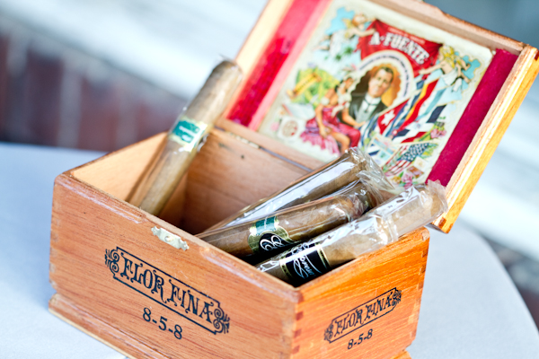 Vintage cigar boxes displayed cigars for guests during cocktail hour.