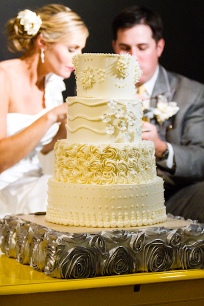 A four tiered ivory confection was crafted for the couple, with intricate piping details which varied by each layer.