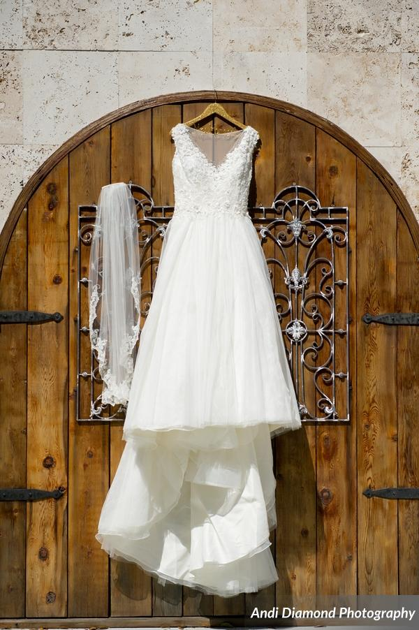 The bride's stunning lace and tulle ballgown with an illusion neckline.