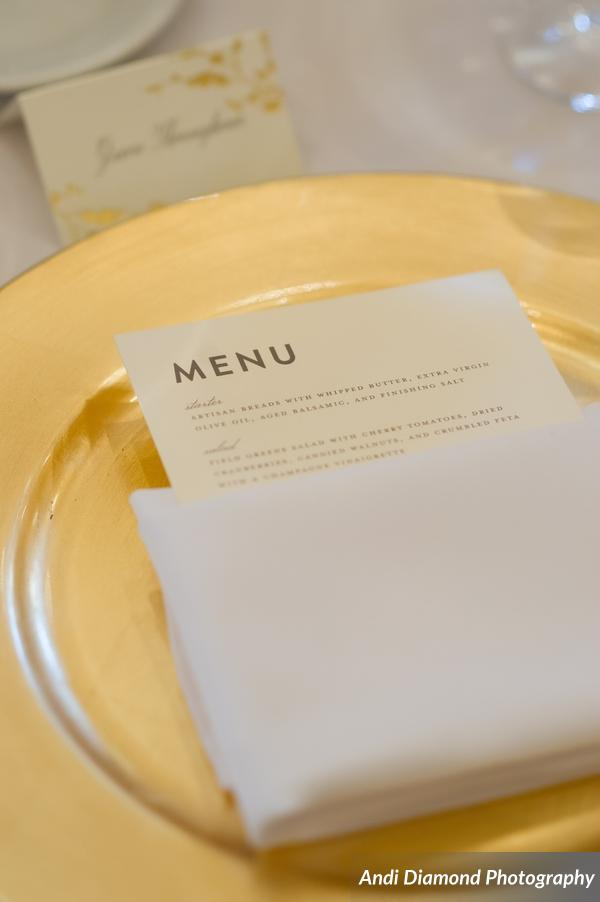 Each place setting featured gold chargers and menu cards for each guest.