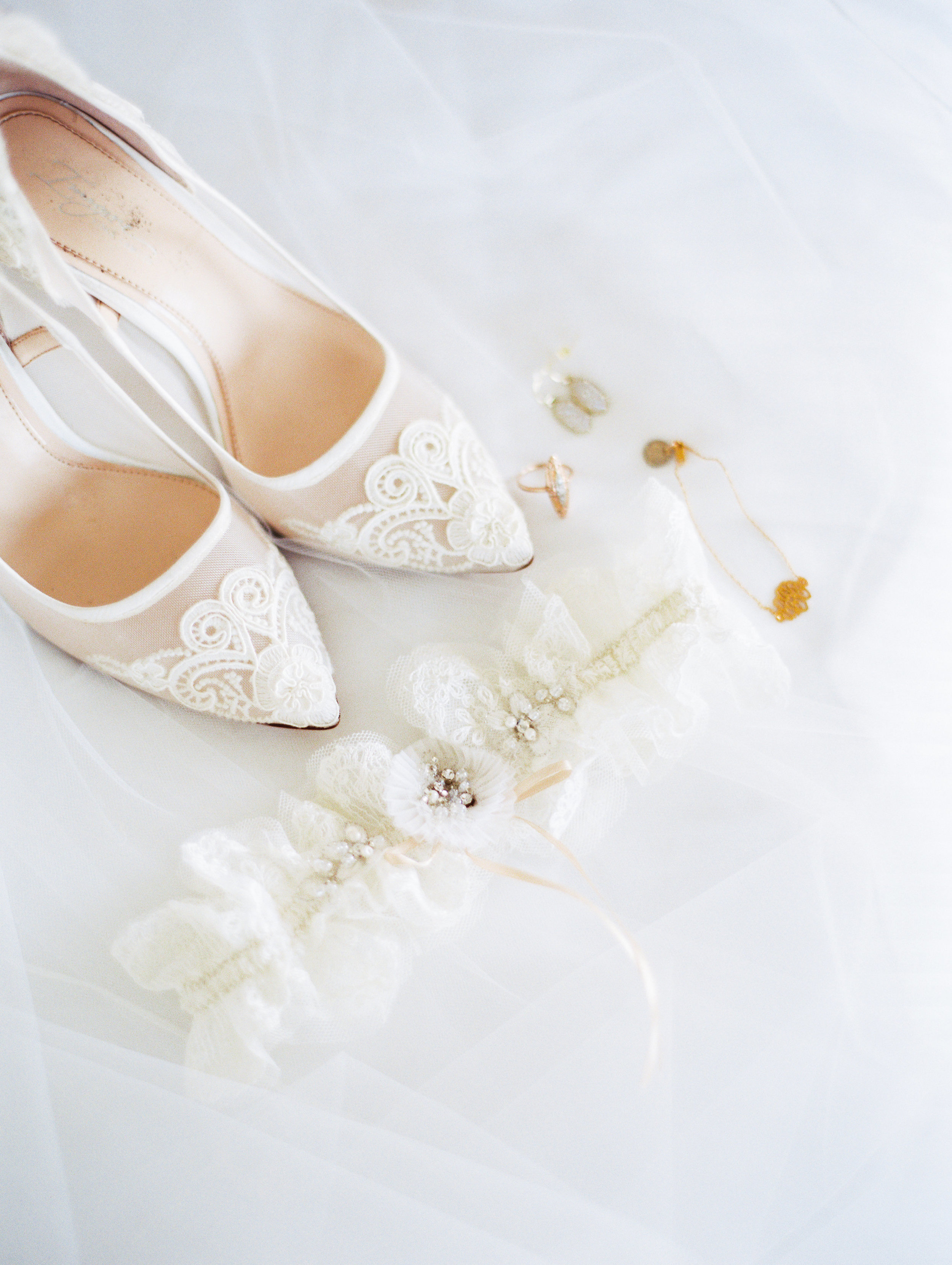 The bride's delicate accessories complimented her flowing lace and tulle wedding gown.