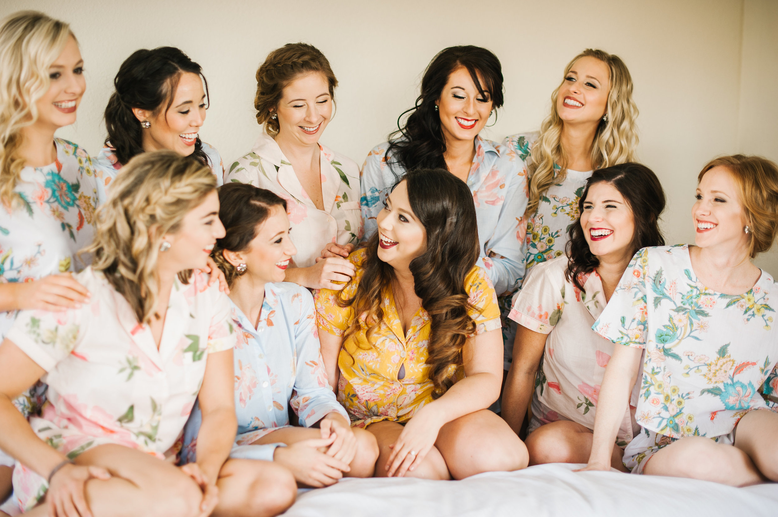 The bride and her closest girls getting ready, and looking adorable, in their mismatched floral pajamas!