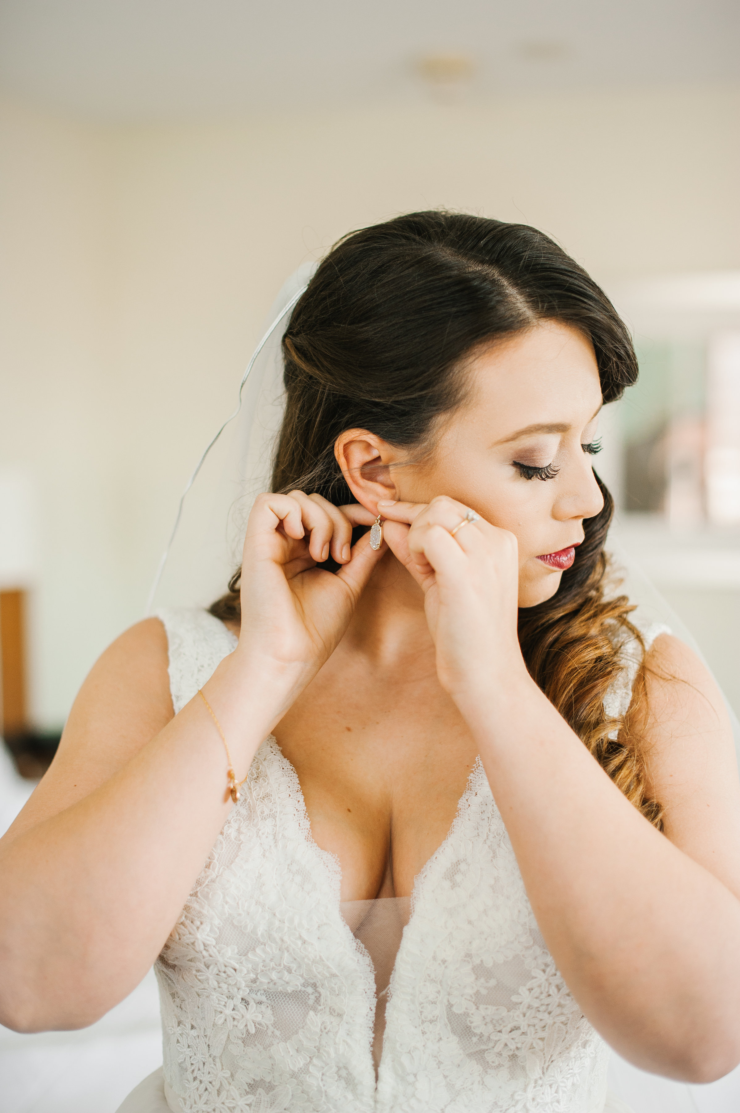 The bride looking stunningly gorgeous in her plunging lace illusion neckline gown.