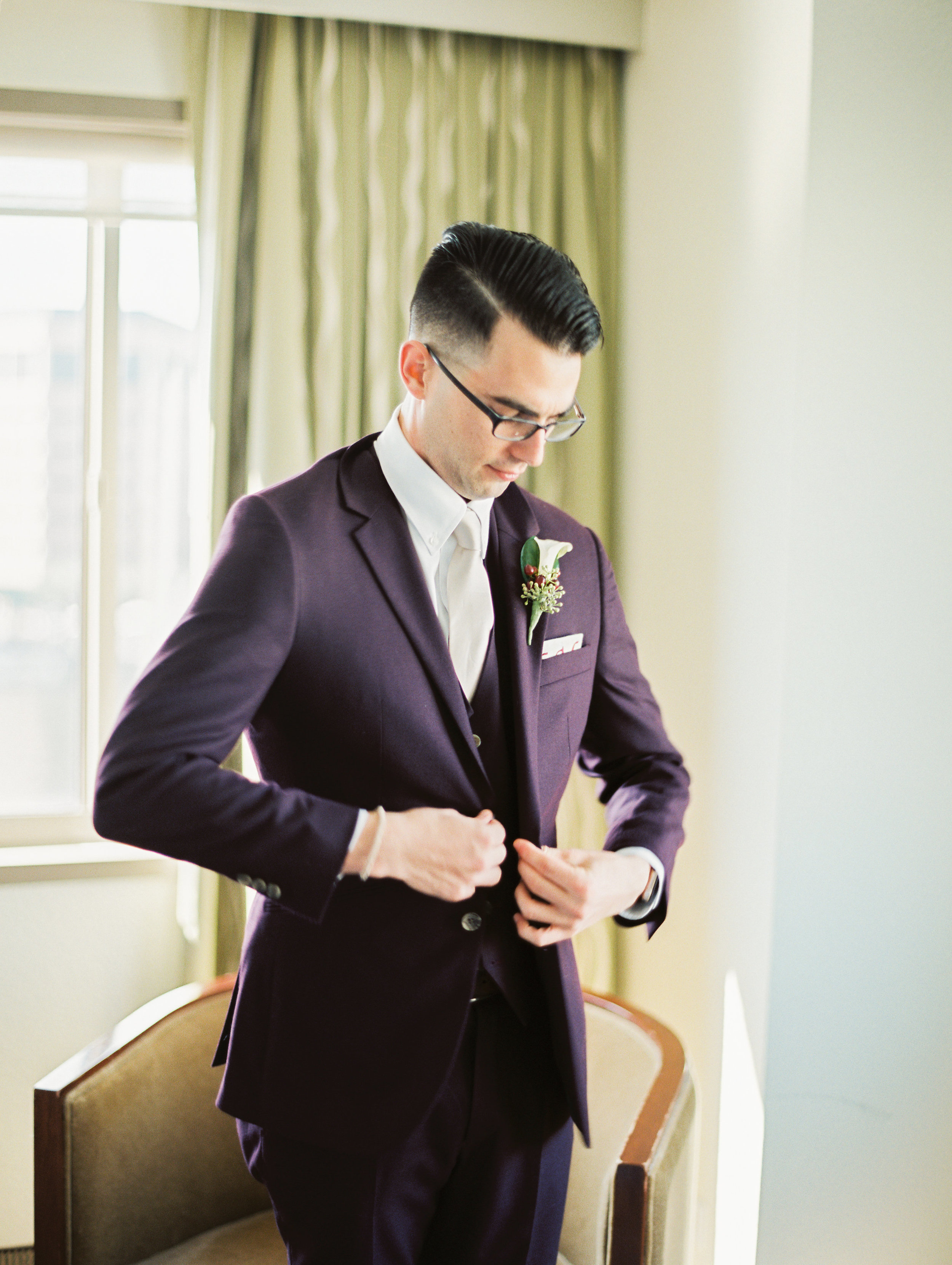 The groom looked dapper in his marsala suit and ivory tie.