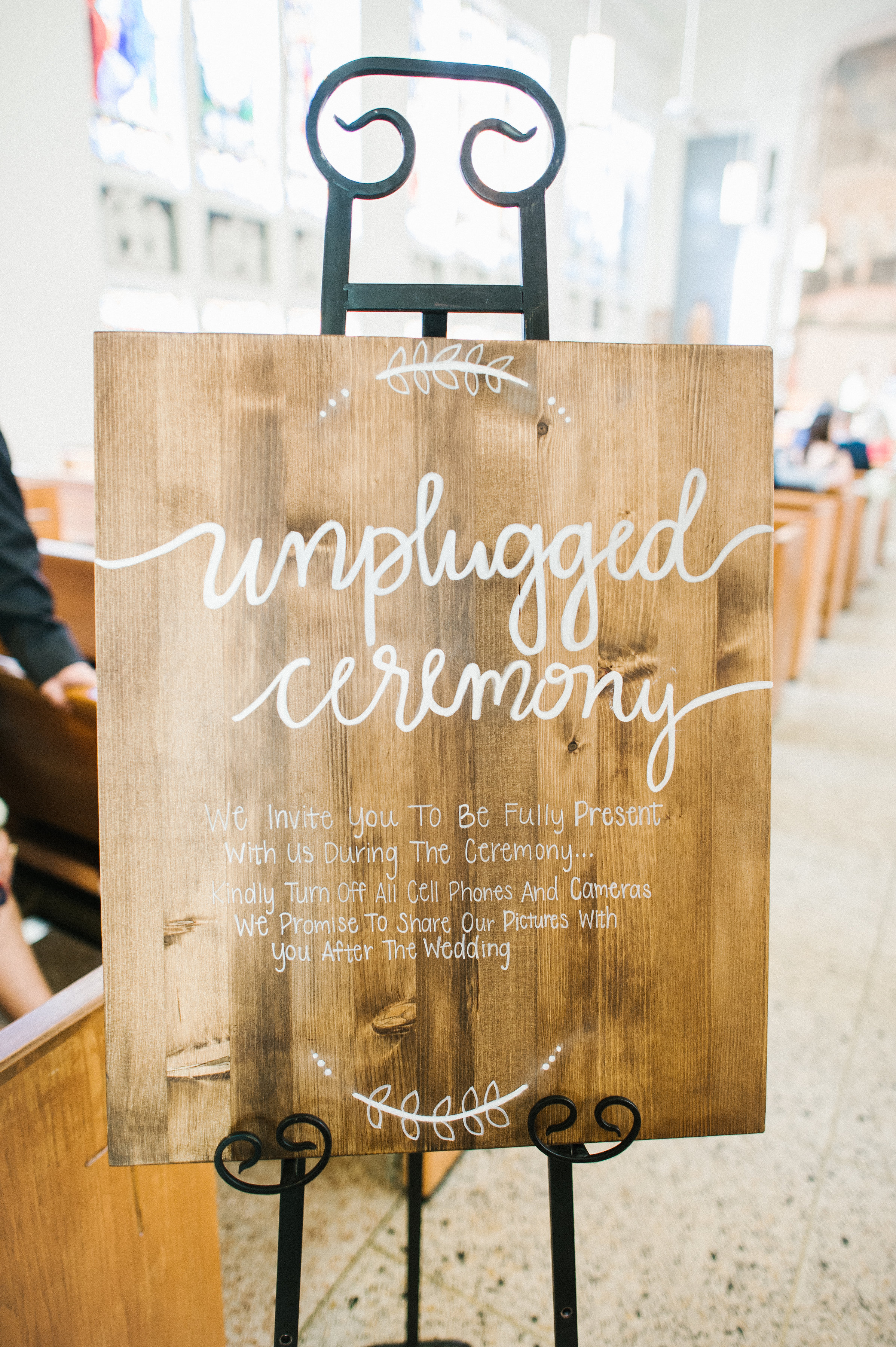To help eliminate any distractions the couple had this adorable sign made for their unplugged ceremony.