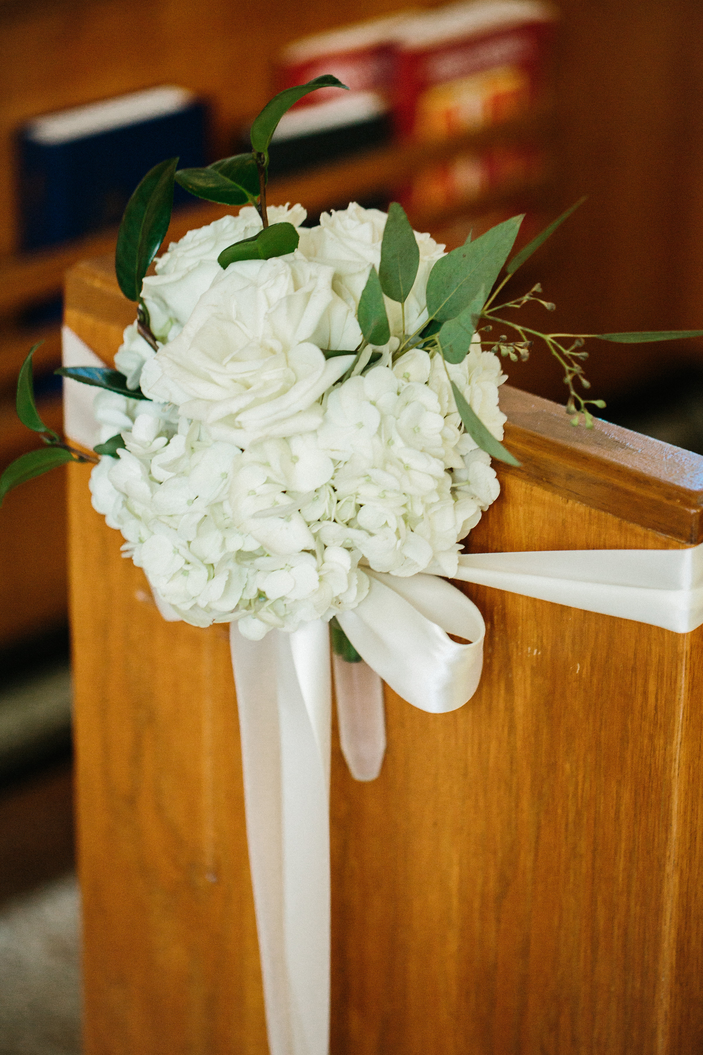Neutral blooms and greenery decorated the ceremony space.
