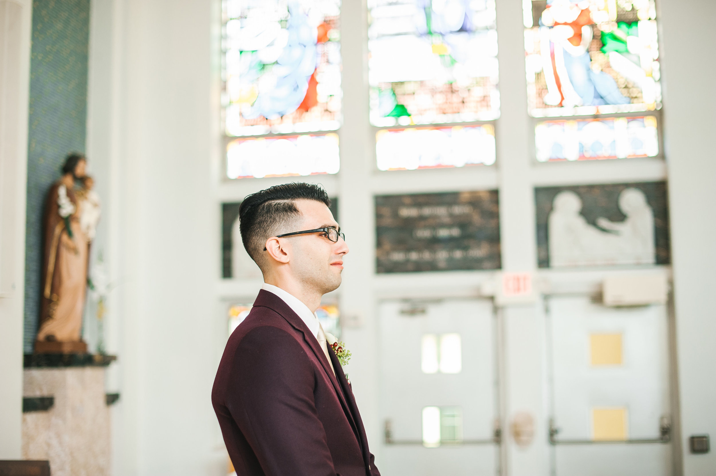 A teary-eyed groom watching his bride walk towards him (always one of our favorite moments).