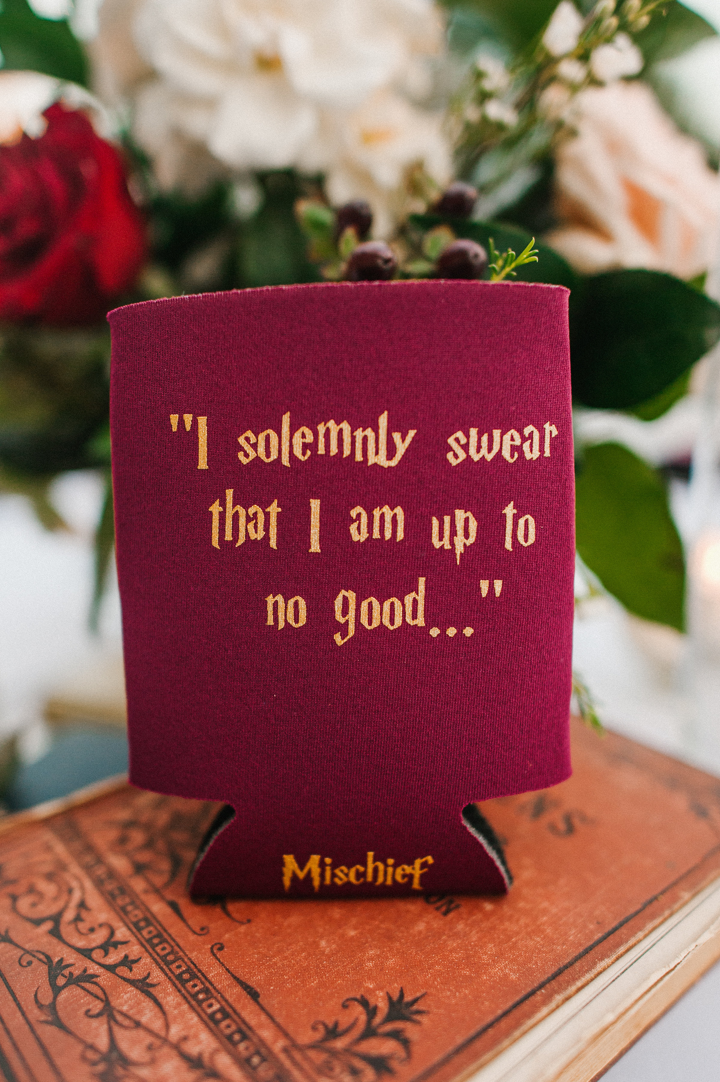 """The couple made sure to infuse as much of their personalities as possible into their wedding, like these custom """"Harry Potter"""" themed favor koozies... Mischief Managed!"""