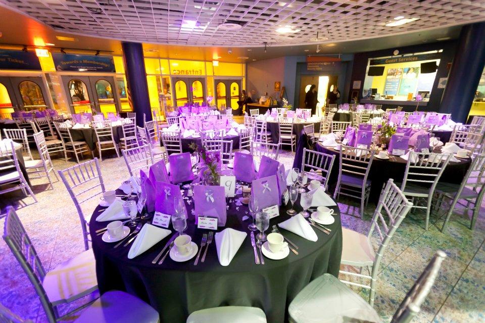 Silver Chiavari chairs sat at tables adorned with live orchids flown in from Thailand and lavender purple favor bags.