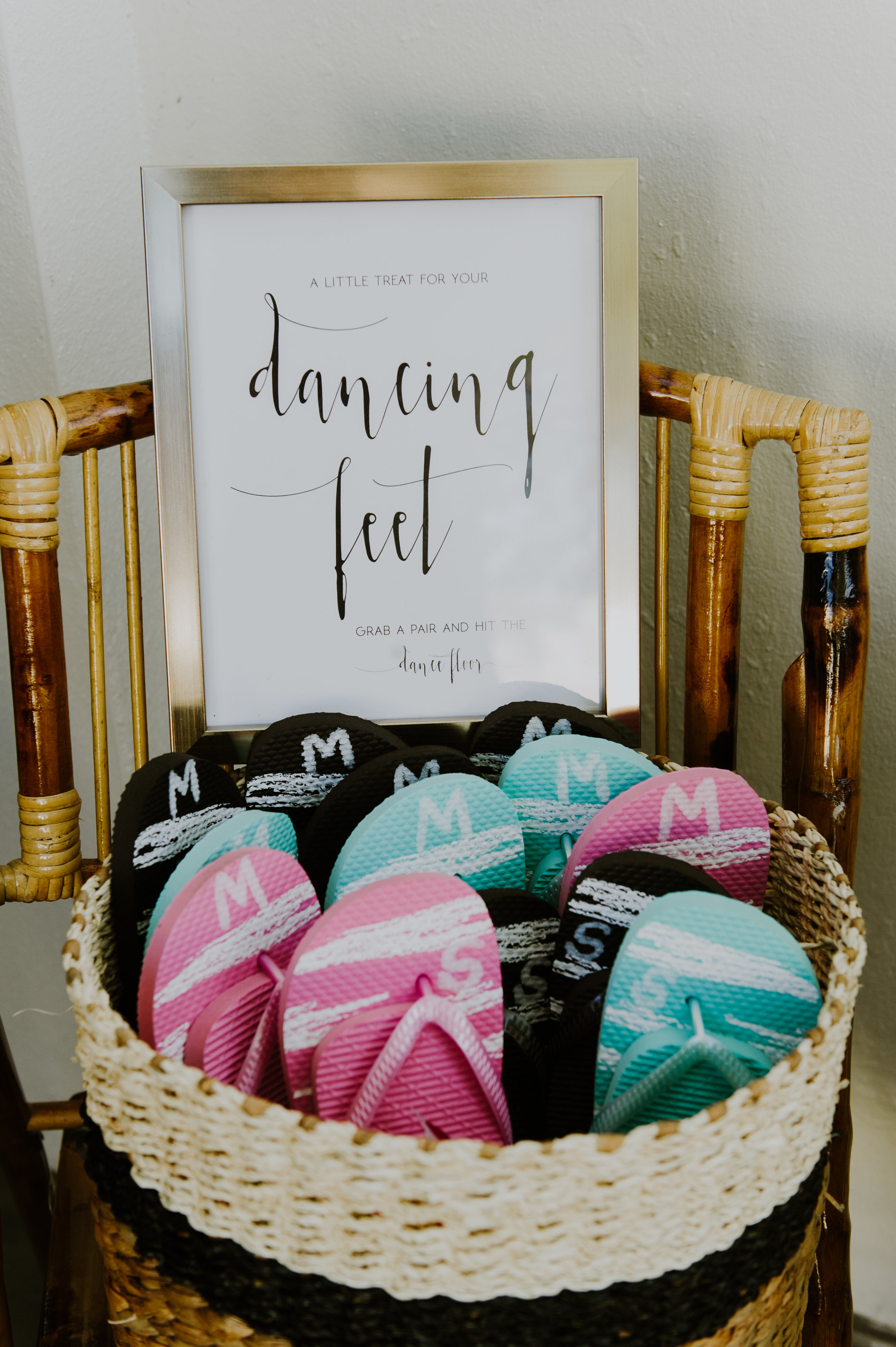 A basket of flip-flops, paired with a cute sign, let guests know it was time to kick off their shoes and dance the night away!