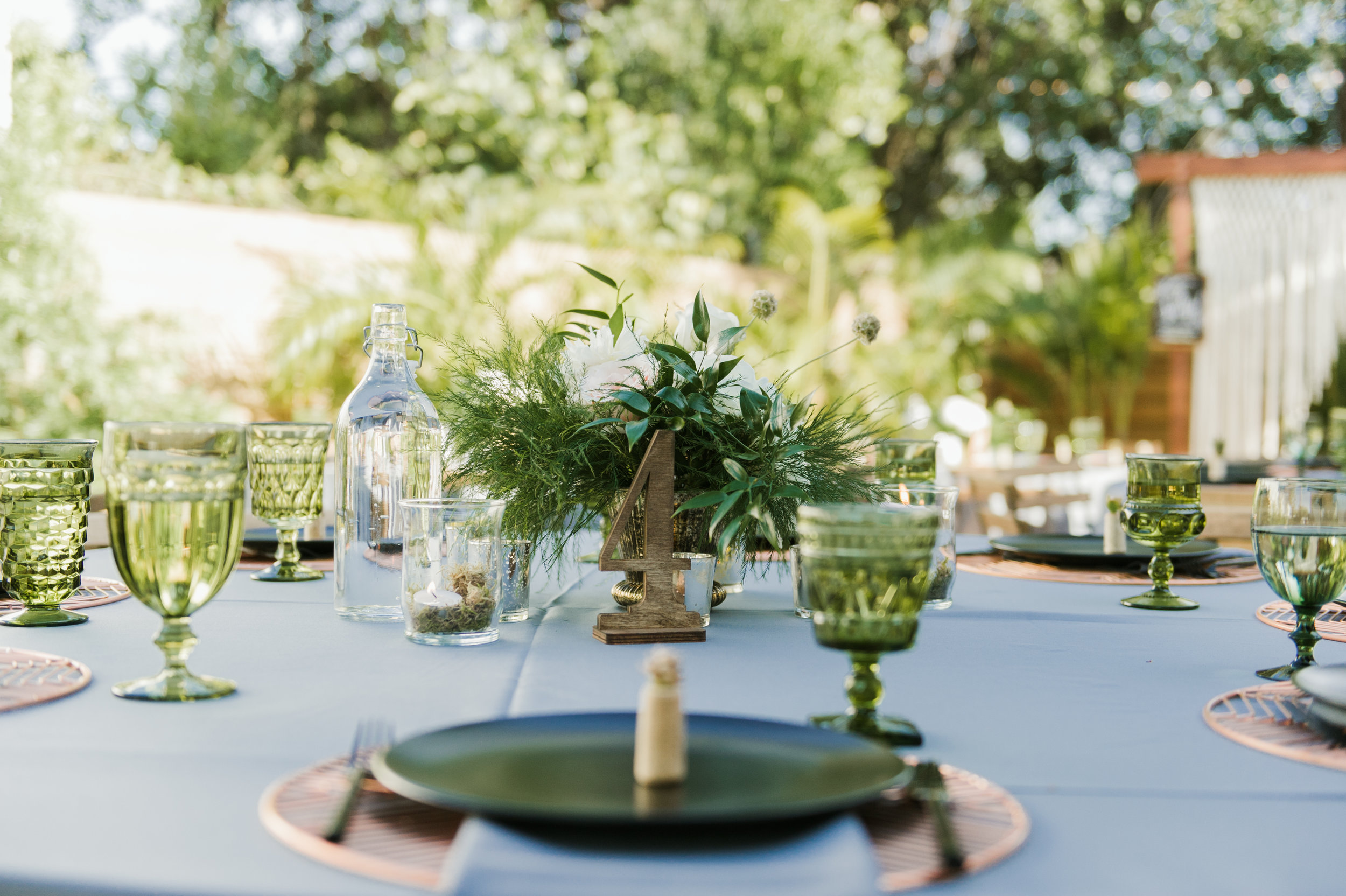 Accents of copper and other metals could also be found on tables, along with delicate succulents planted in wine corks at every place setting.