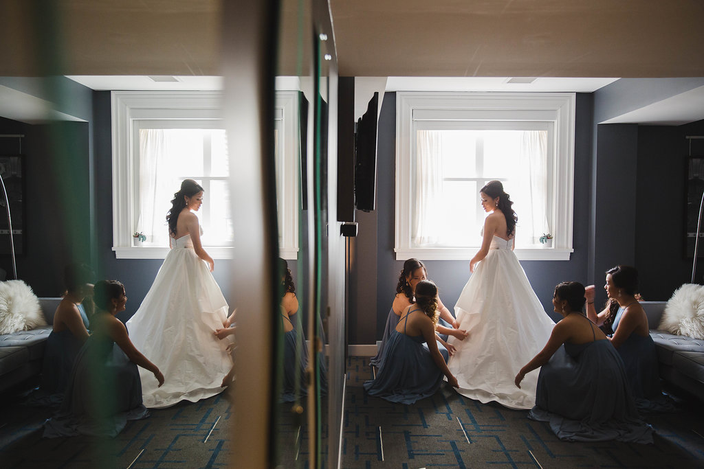 Her doting bridesmaids made sure every little detail and finishing touch was perfectly in place for the stunning bride.