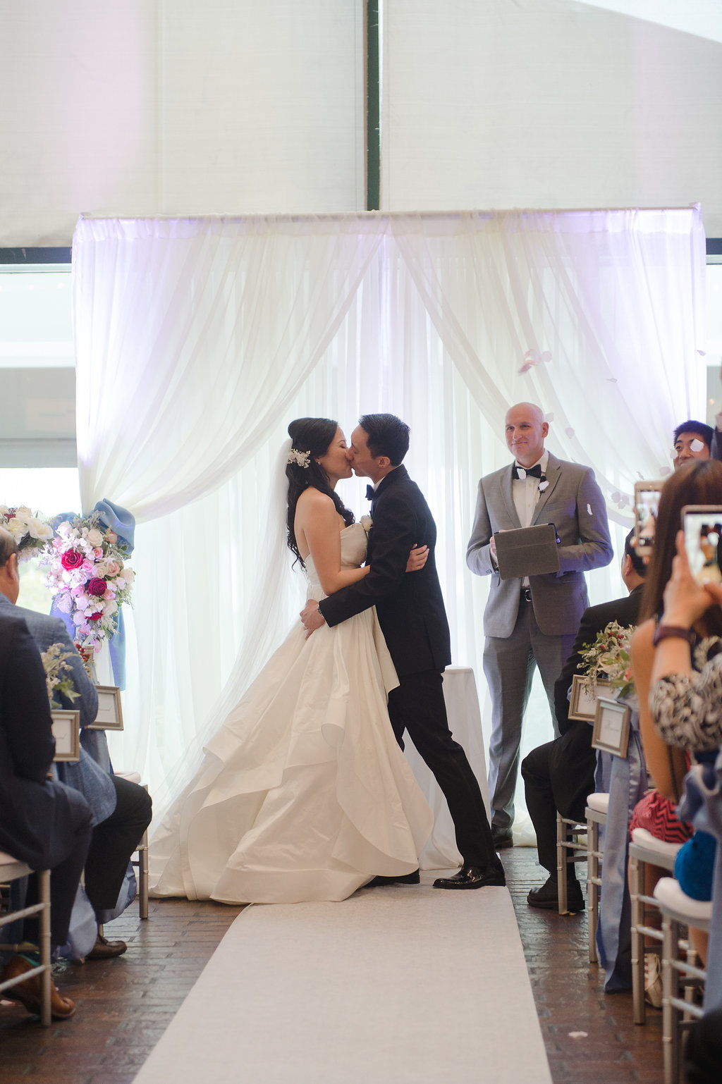 A harpist serenaded the bride's entrance, and the couple exchanged vows led by their church's pastor.