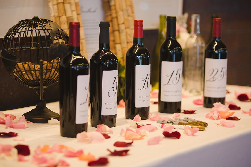 The guestbook featured wine bottles the guests could sign during the wedding which the couple would open on those special anniversaries.