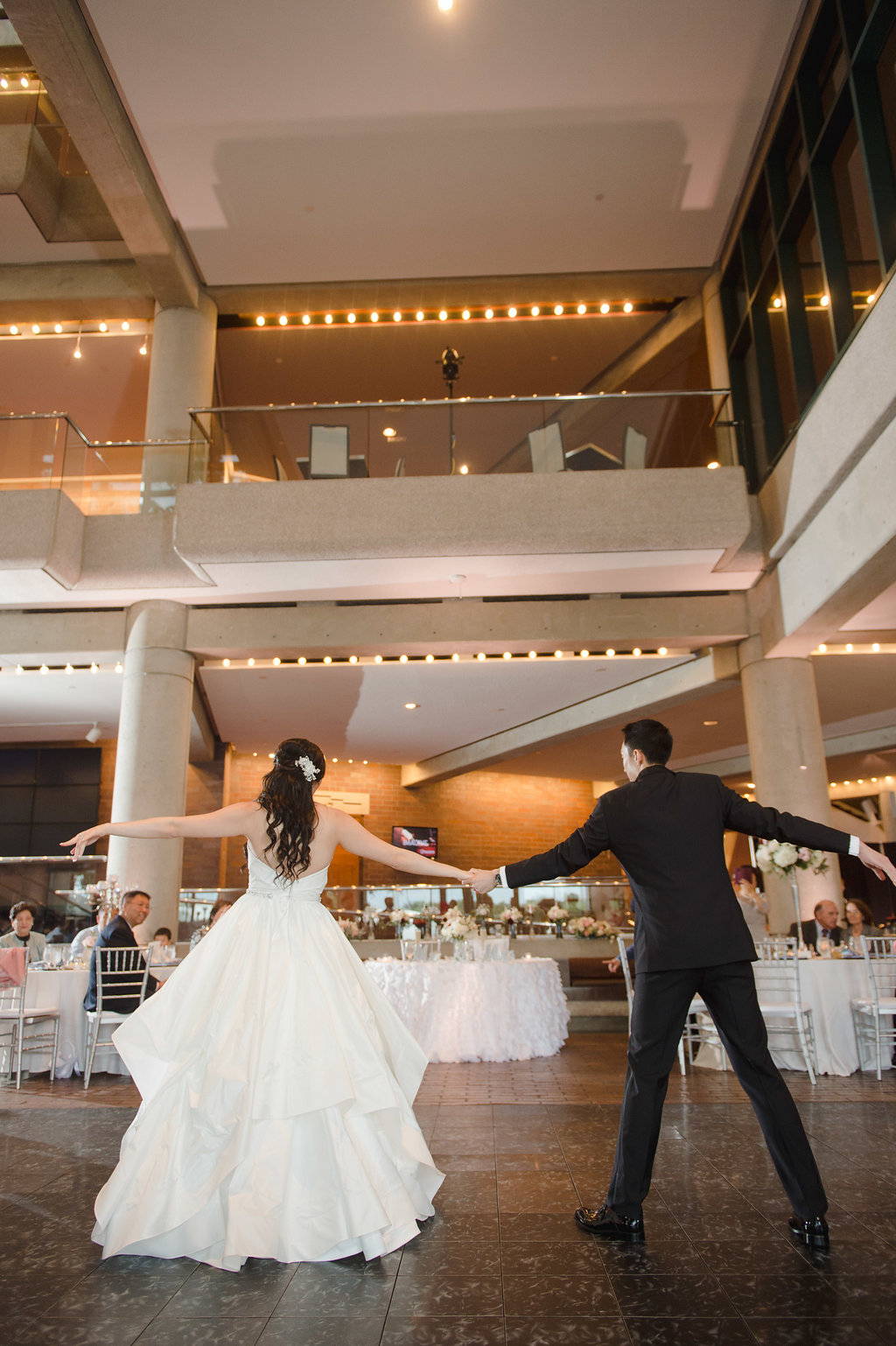 How gorgeous was the bride's strapless ivory gown with an asymmetrical tiered skirt?!