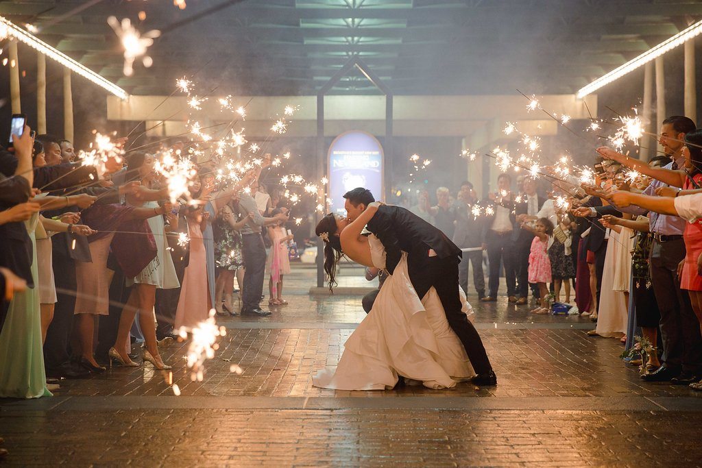 After dancing and dining (and delicious cake) the couple were sent off through the marquee-bulb theater entrance with a tunnel of sparklers.