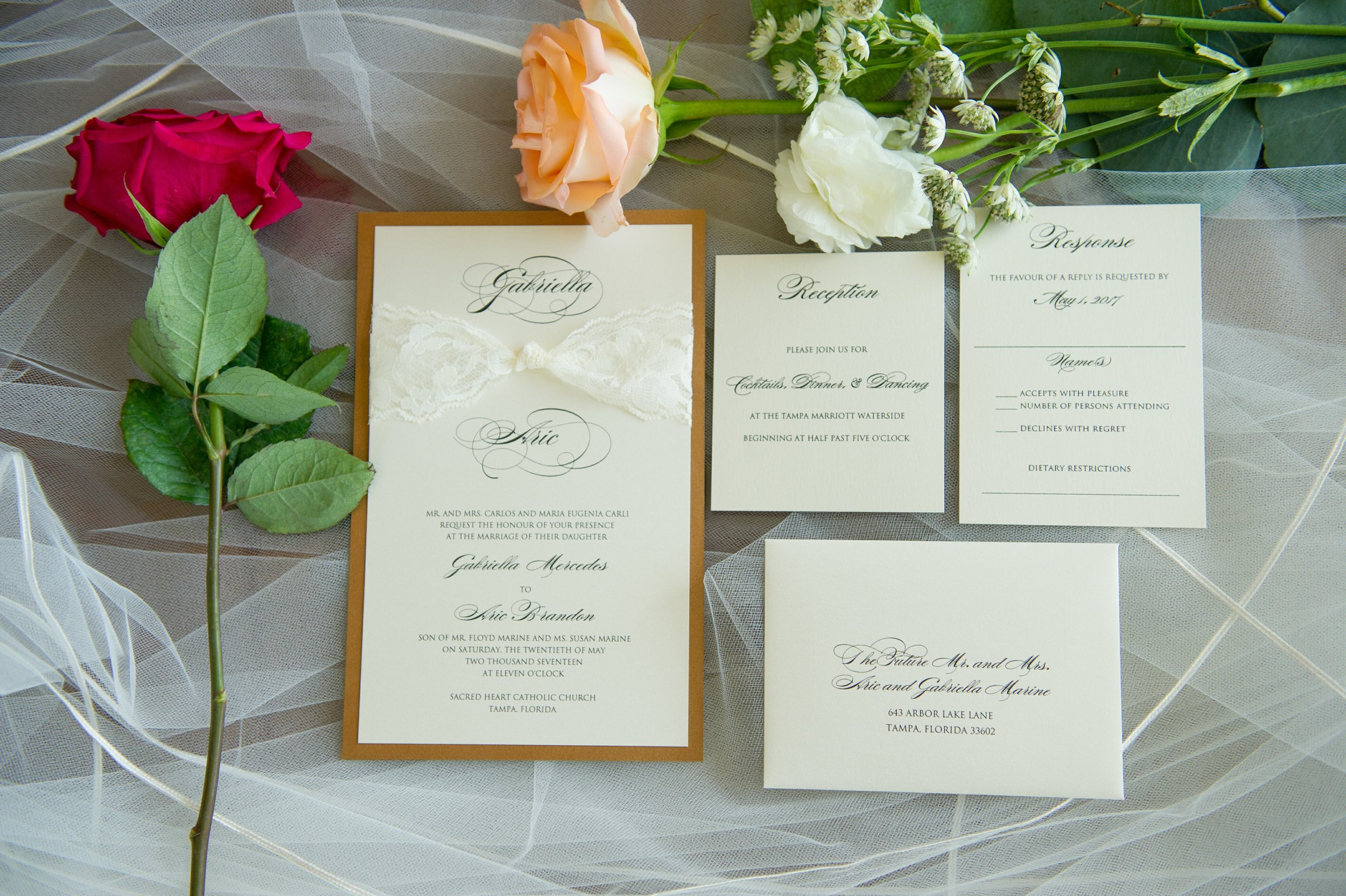The classic style invitation suite with calligraphy script featured copper and lace details to add in some vintage aspects to the clean design.