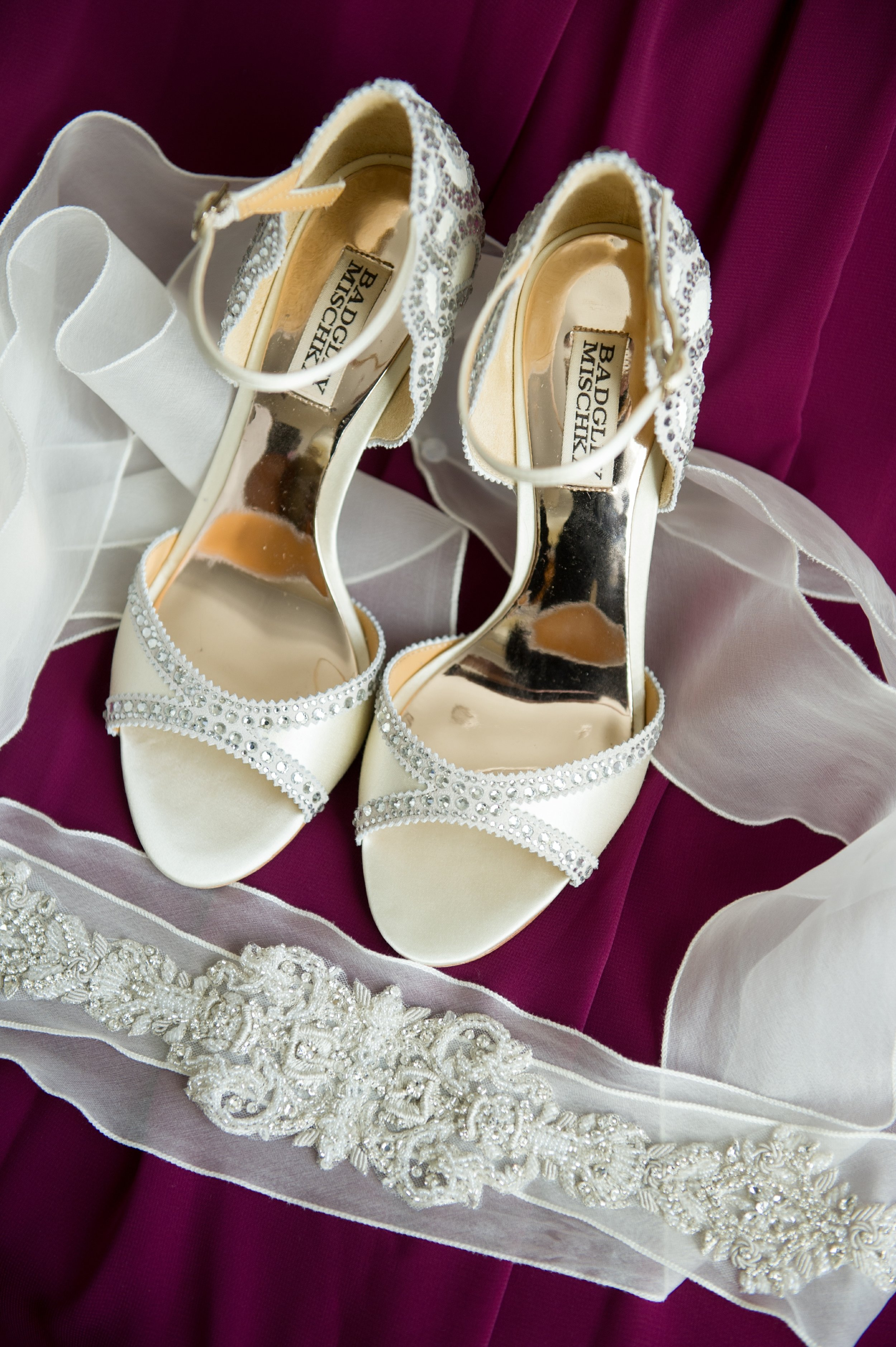 The bride wore striking white, crystal-studded Badgley Mischka heels, and an embroidered beaded sash.