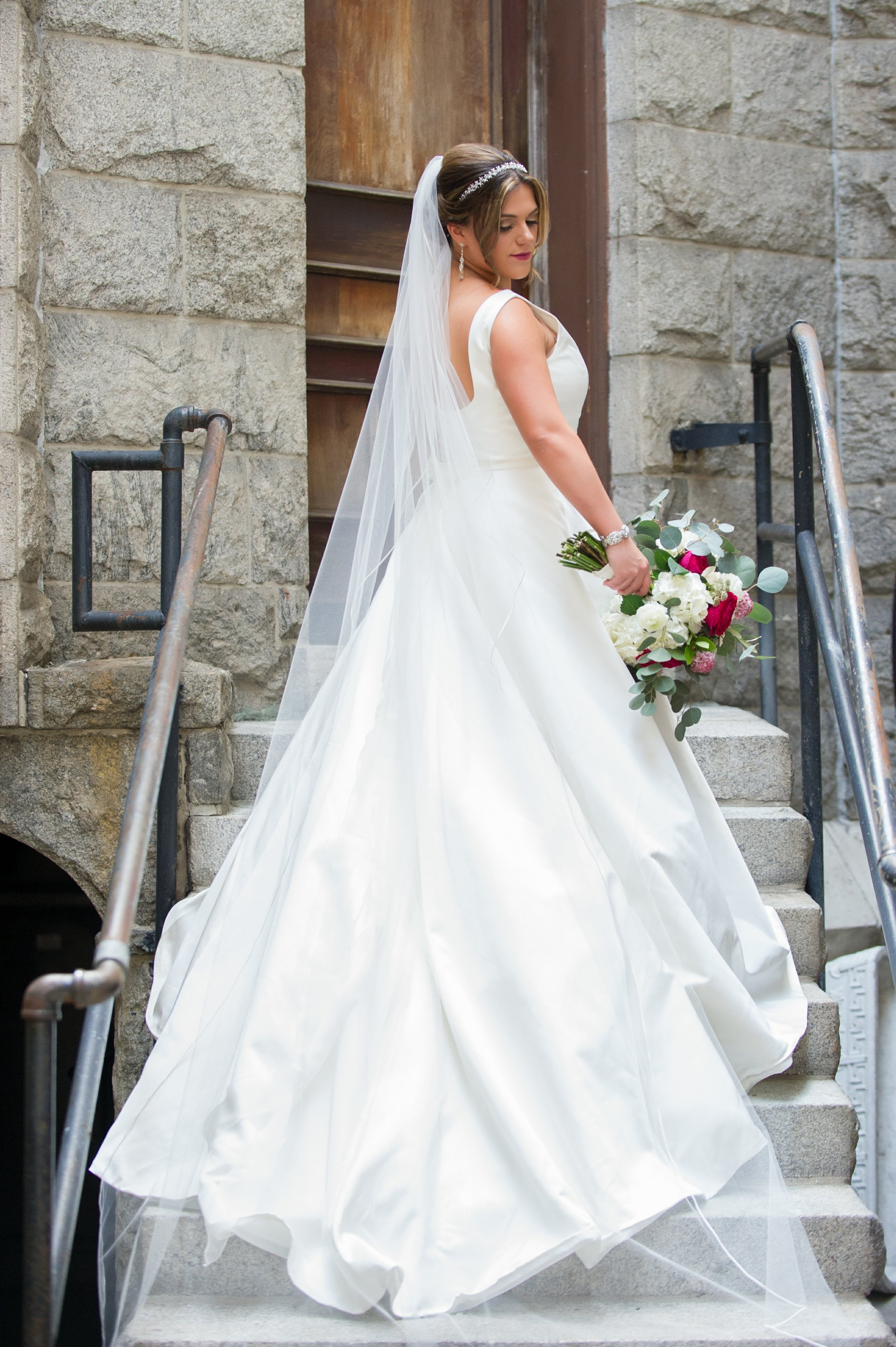The bride looked simply beautiful in her white gown and cathedral length veil, with delicate crystal accents.