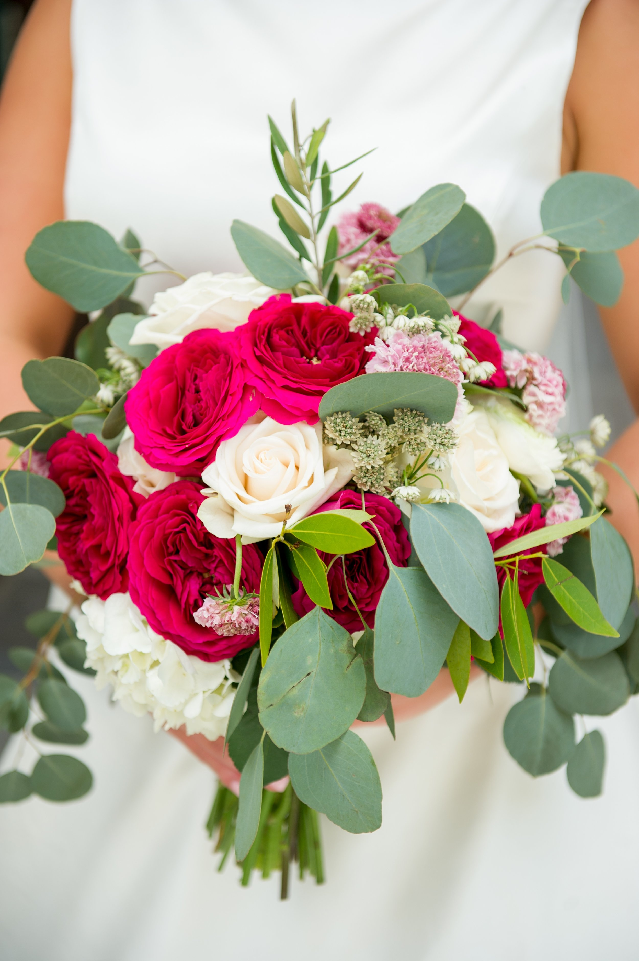 The bride's bouquet consisted of ivory roses, white hydrangea, red garden roses, pink scabiosa, leafy eucalyptus and sage, and delicate Queen Anne's lace (gorgeous!)