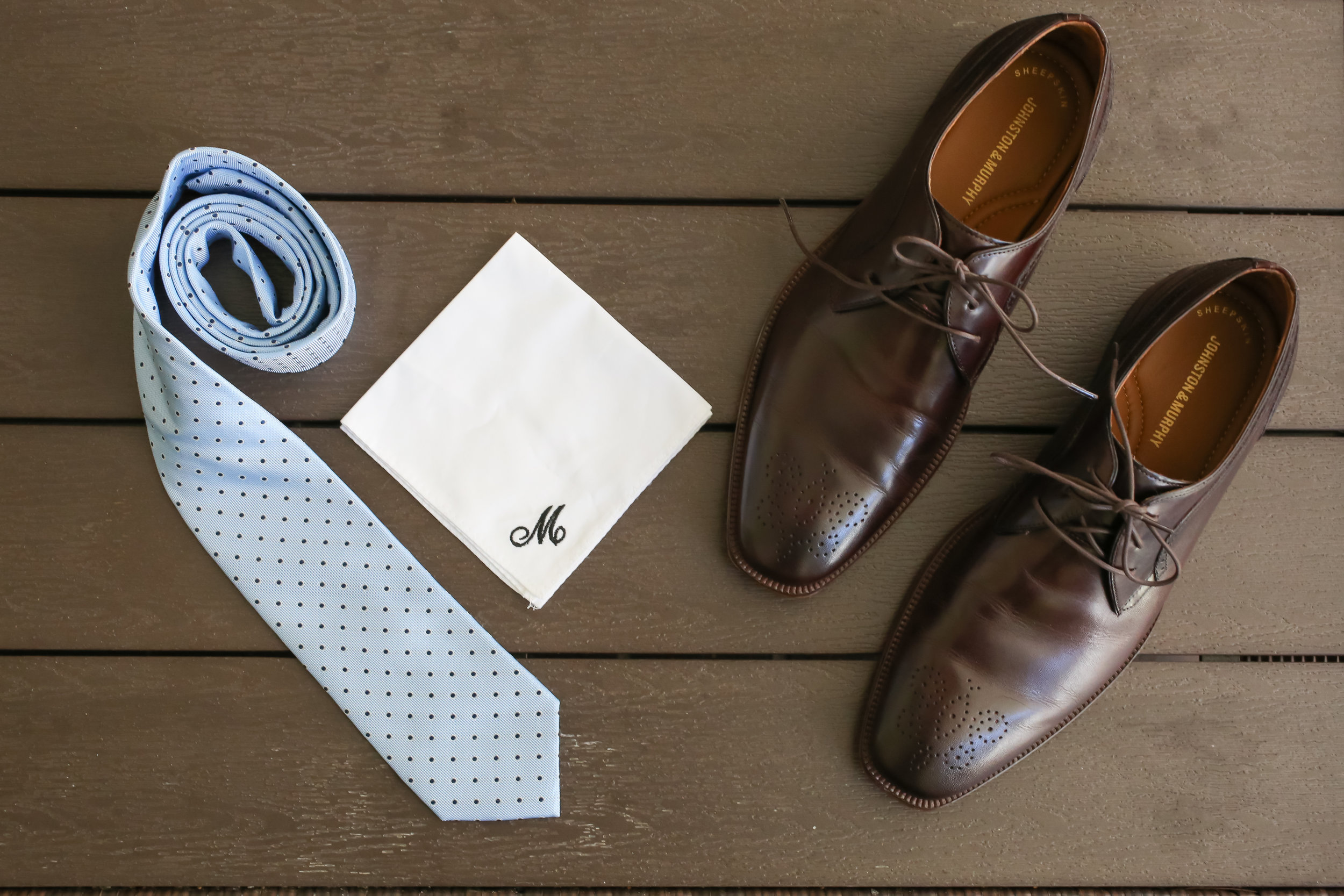 The groom sported a sky blue tie to accent his navy suit, and a custom monogramed pocket square.