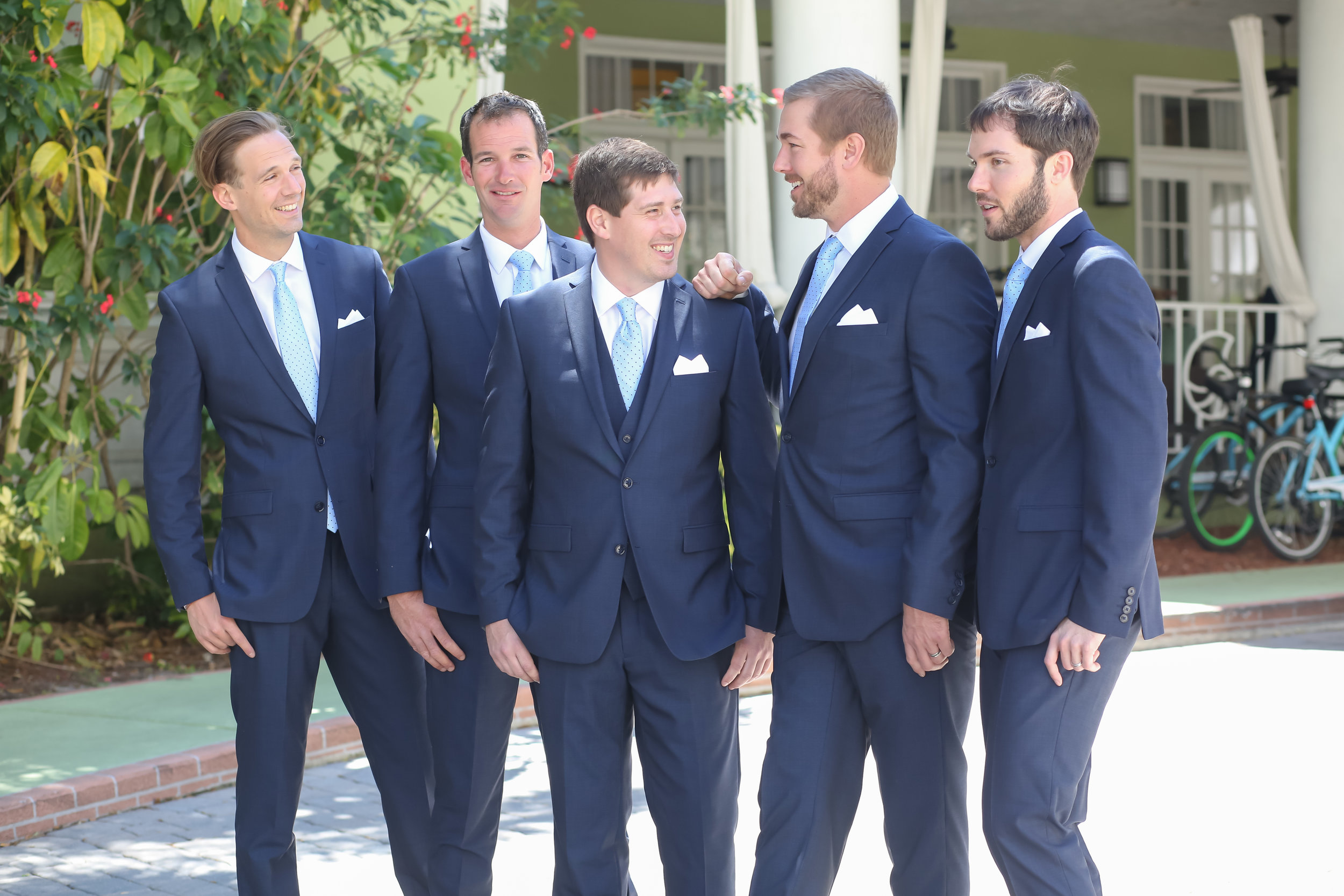 The gentlemen sported navy suits with soft blue and white adornments.
