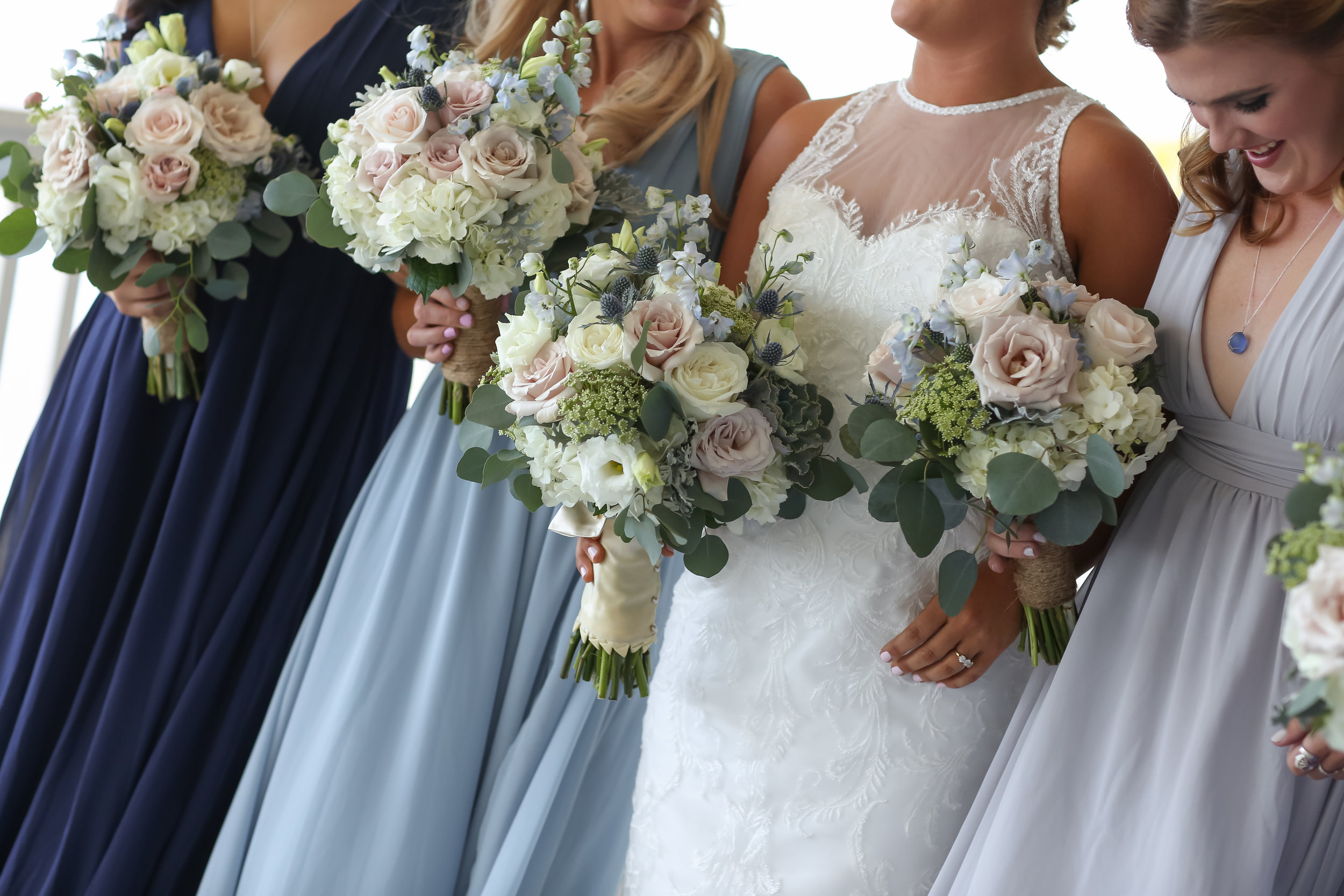 Bridesmaids wore chiffon dresses in varying shades of seaglass, to compliment their soft, organic bouquets.