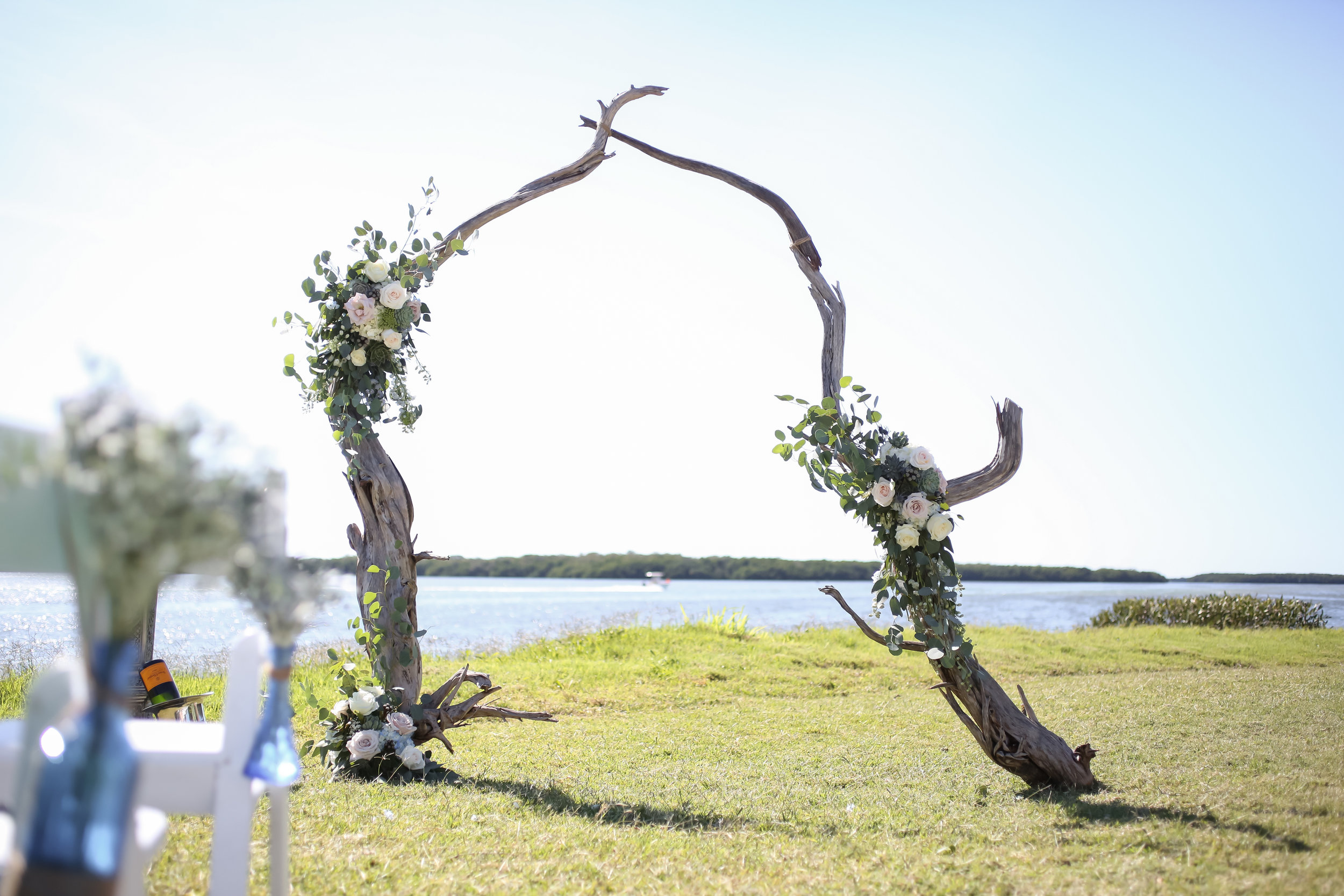 The couple exchanged vows in front of a jaw-dropping arch made from large driftwood branches accented with flora.