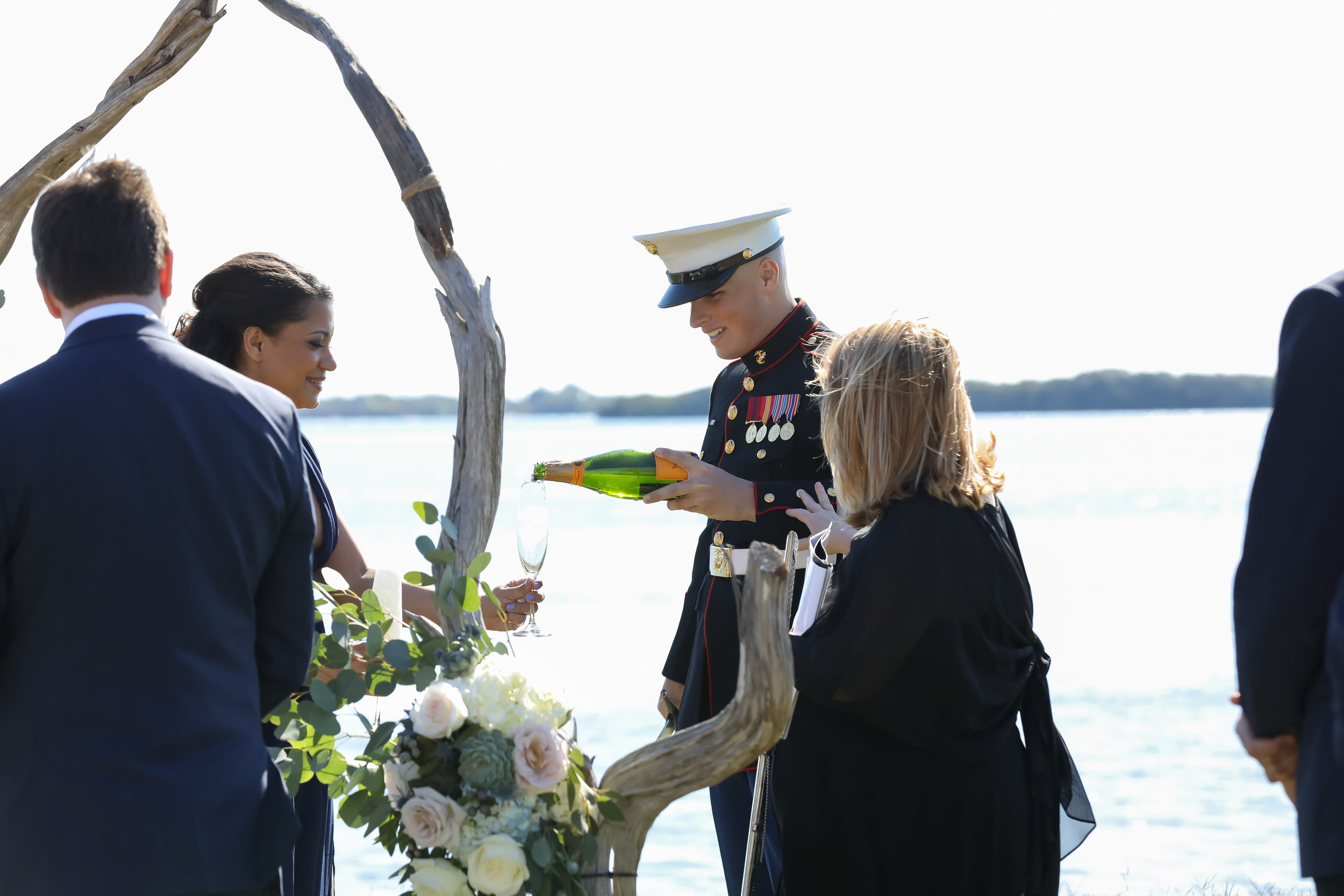 The bride's brother, dressed in full uniform, sabered a bottle of champagne for a ceremonial toast before the couple was pronounced husband and wife.