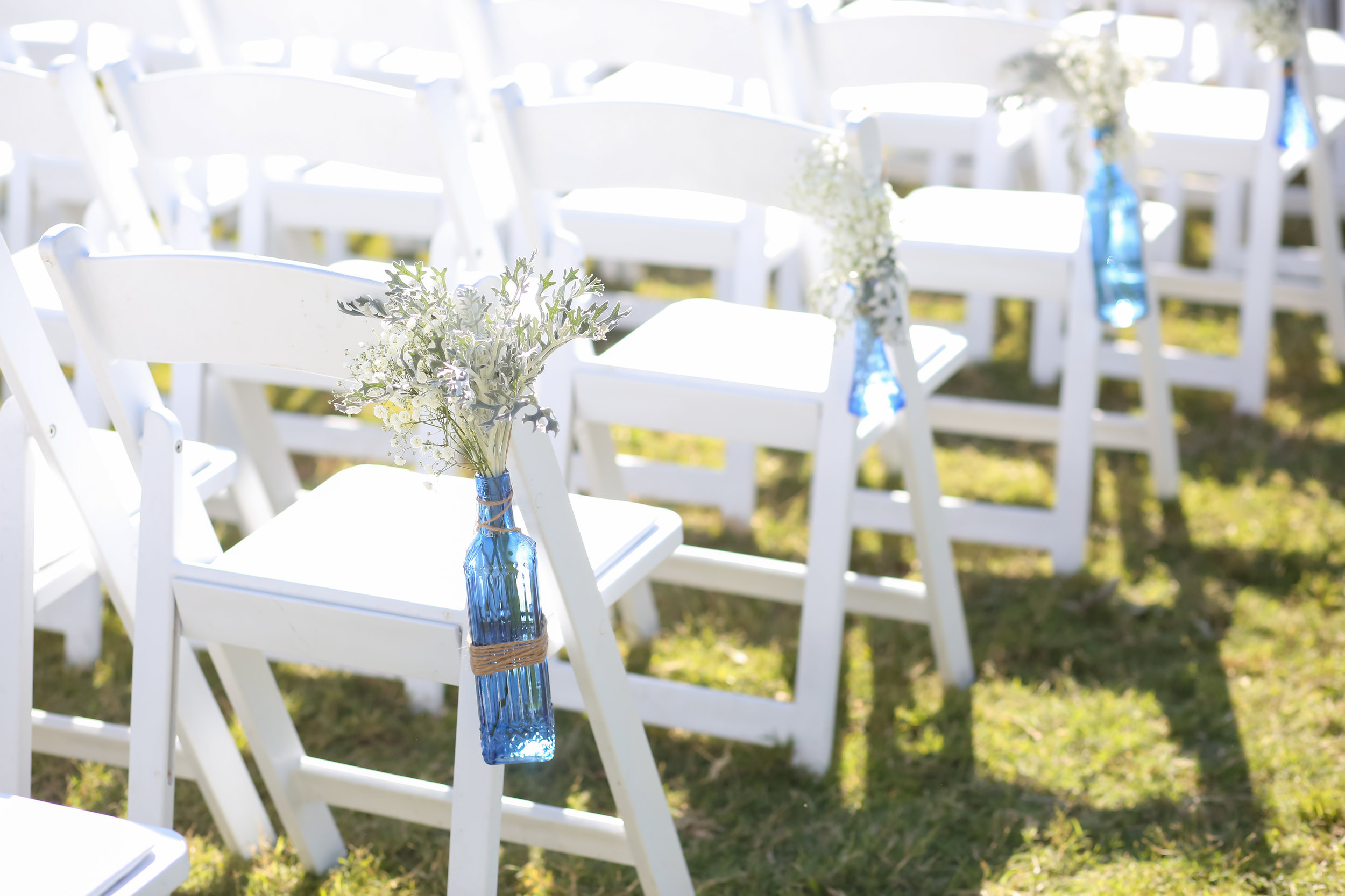 Watercolor blues and glass bottles added a nautical element to the decor.