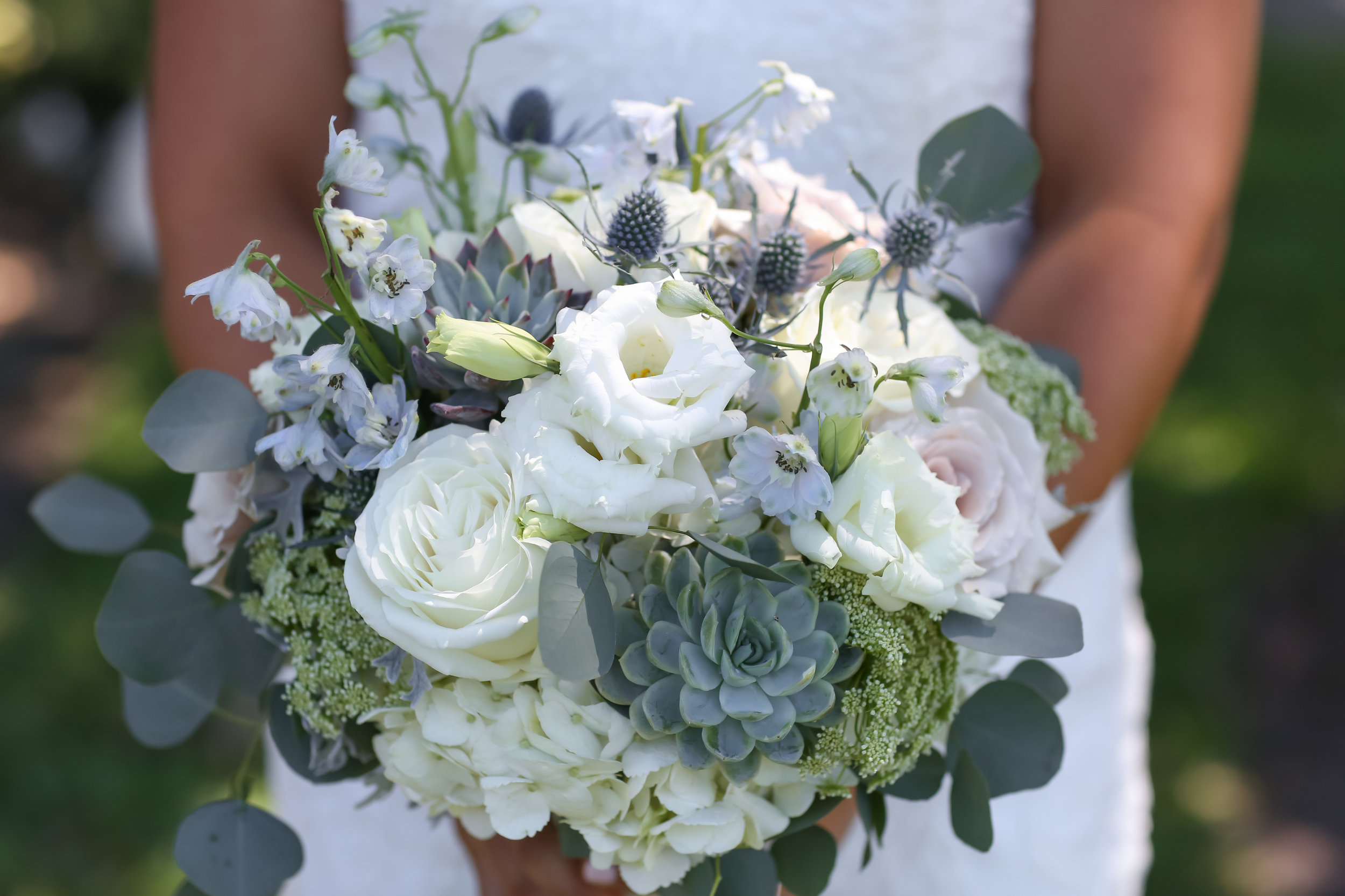 The bride's bouquet was wrapped with a sentimental piece of fabric from her grandmother's dress.