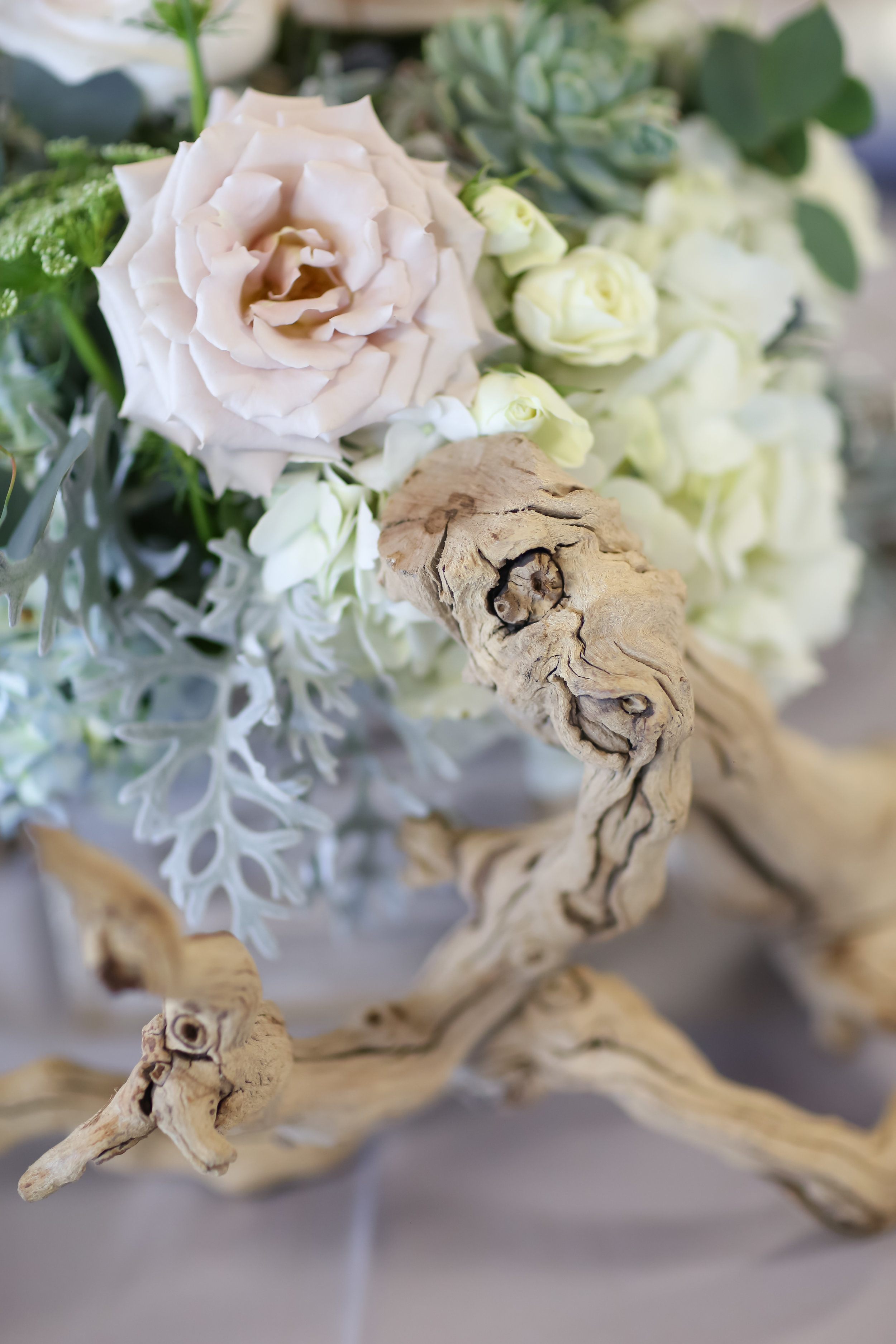 Driftwood accents were incorporated into the floral arrangements.